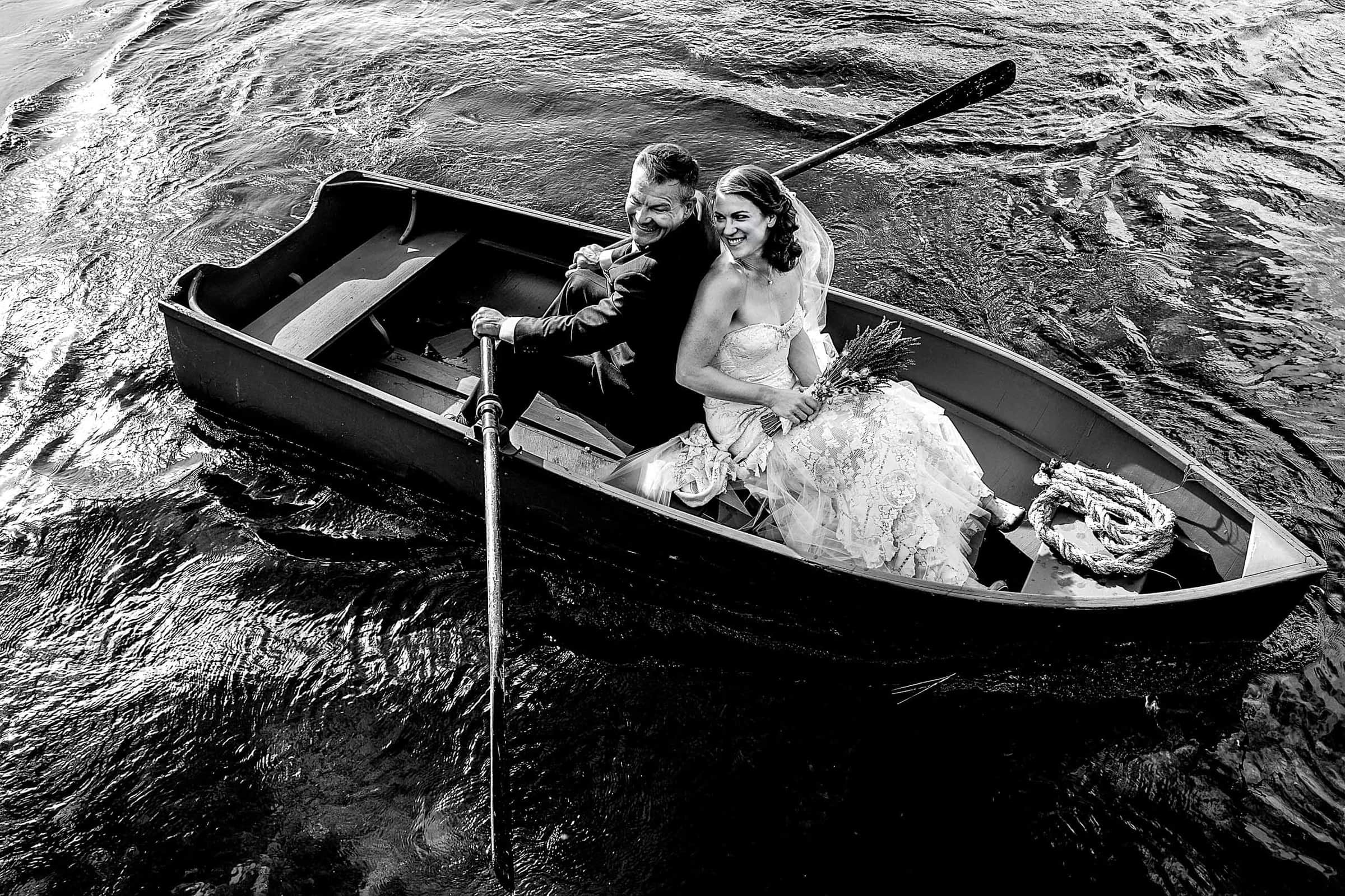Bride and groom in a row boat during their House on Metolius wedding