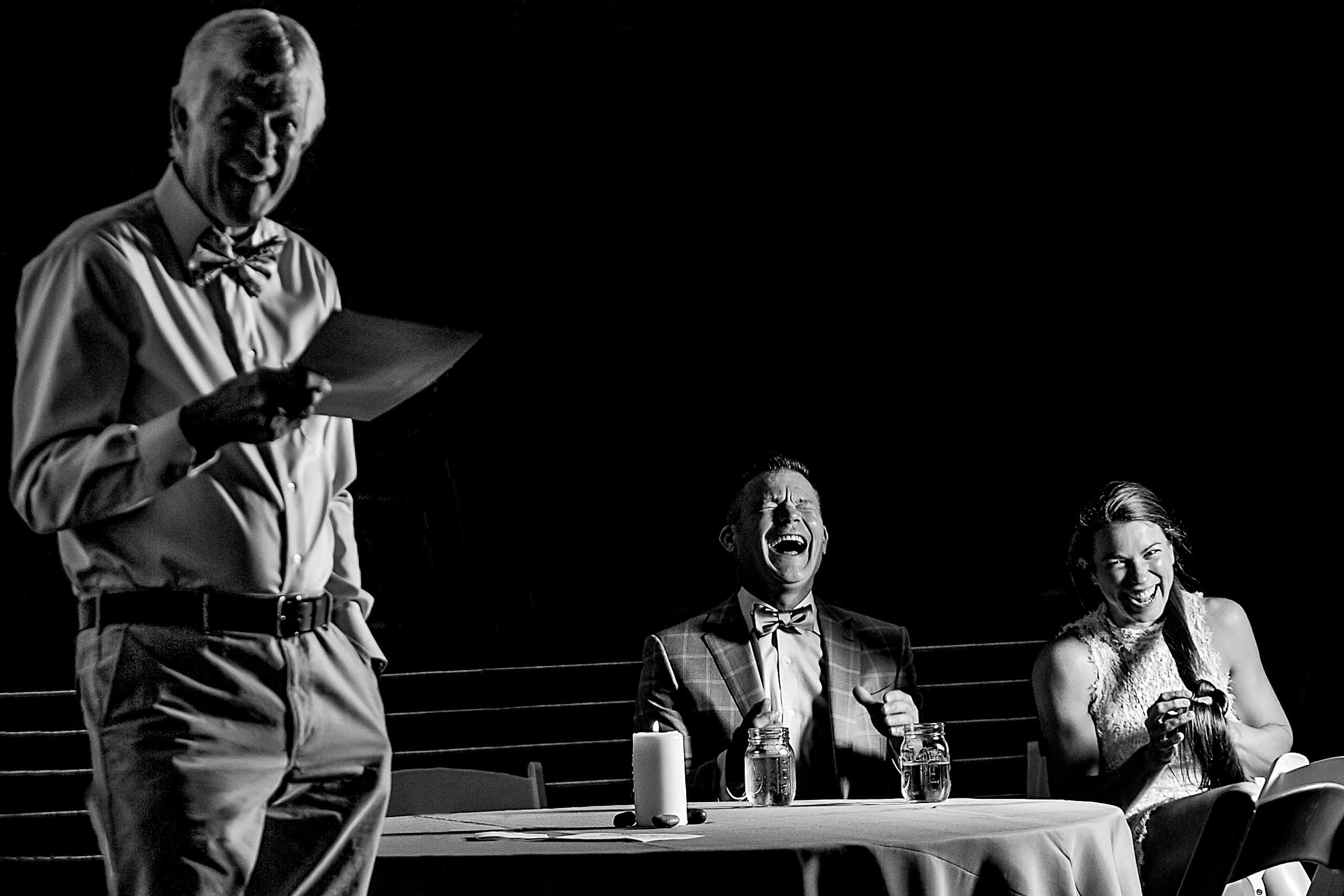 Laughing photo of father giving speech during a House on Metolius Wedding