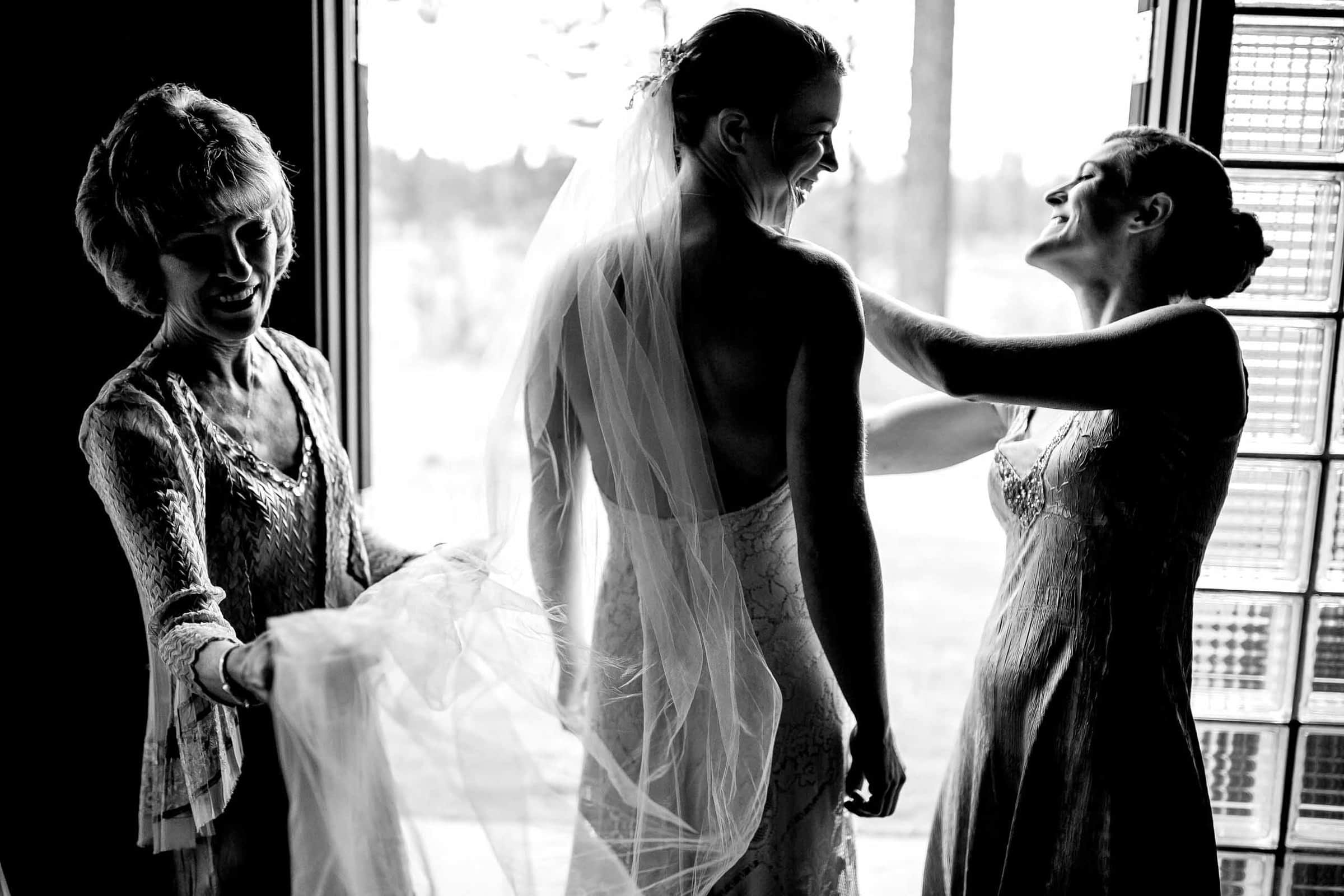 Bride getting ready with her mother and best friend for her House On Metolius wedding