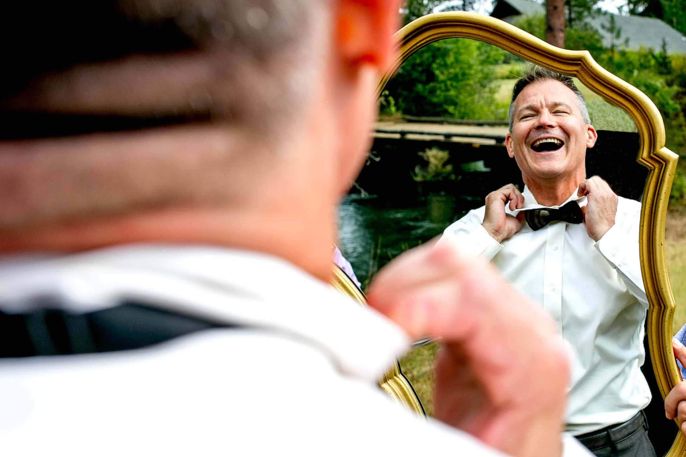 Groom getting ready with his best friend moments before his House On Metolius wedding
