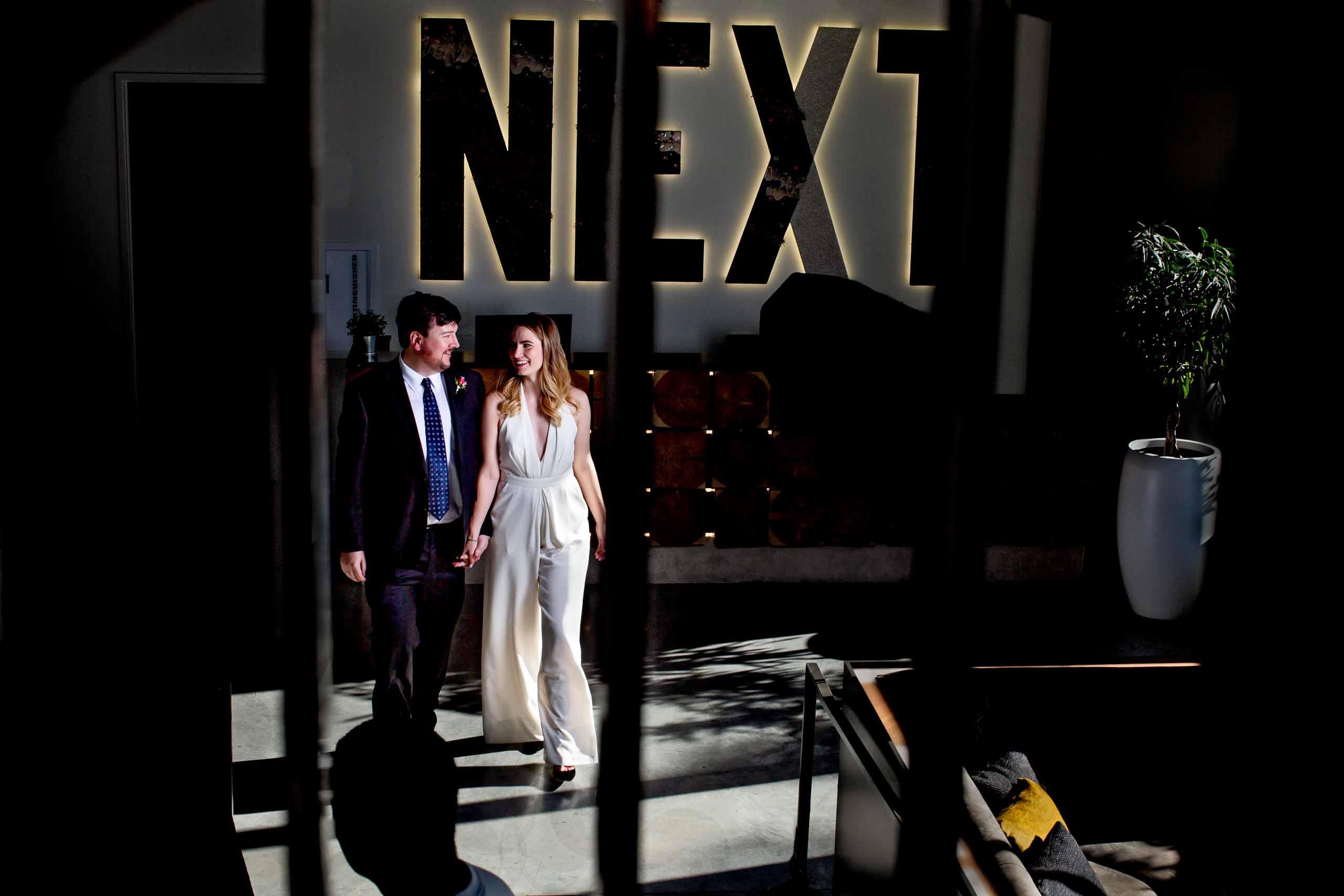 Bride and groom walking together before their Jupiter Next wedding