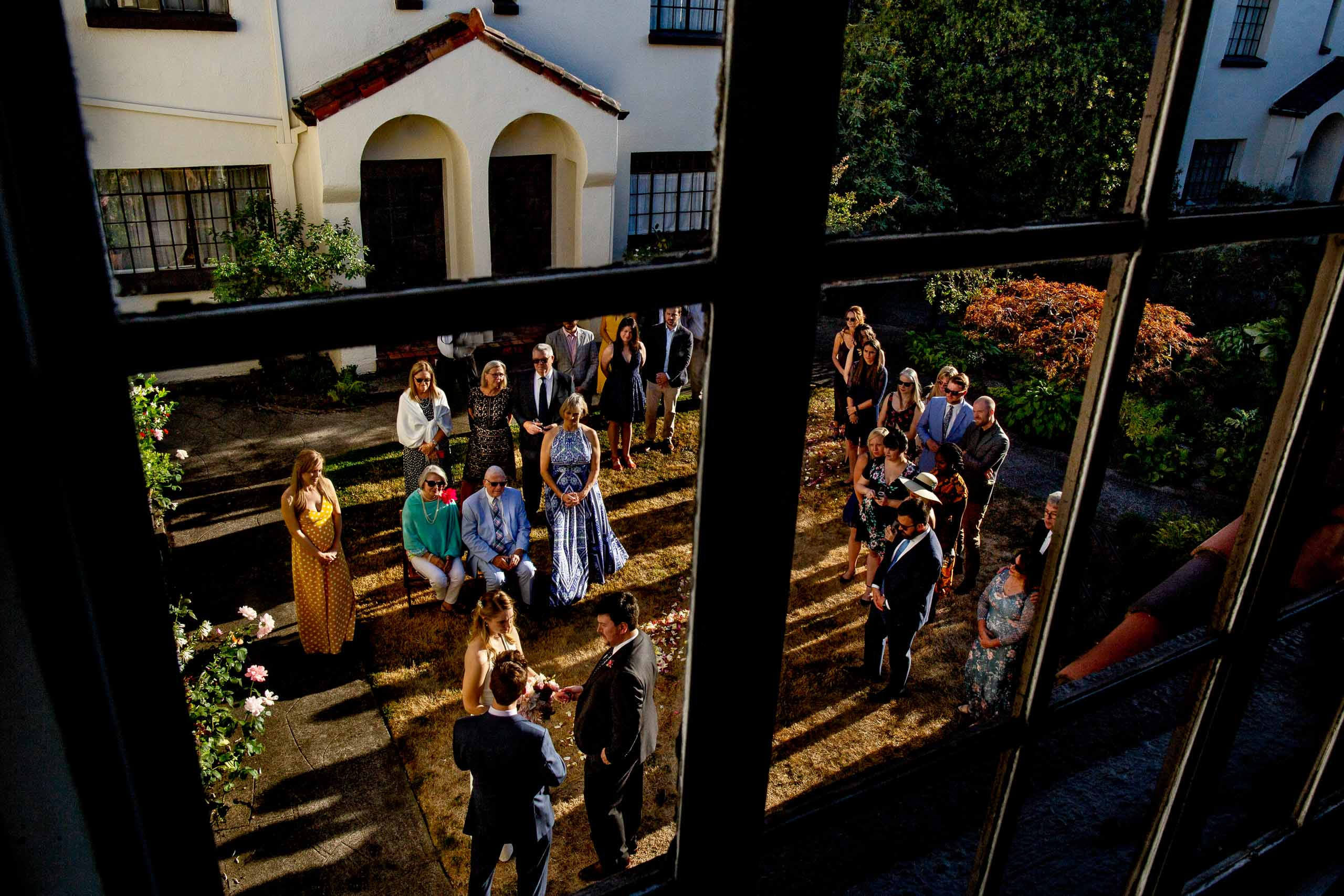 Bride and groom exchanging vows outside in their condo courtyard during their Jupiter Next wedding