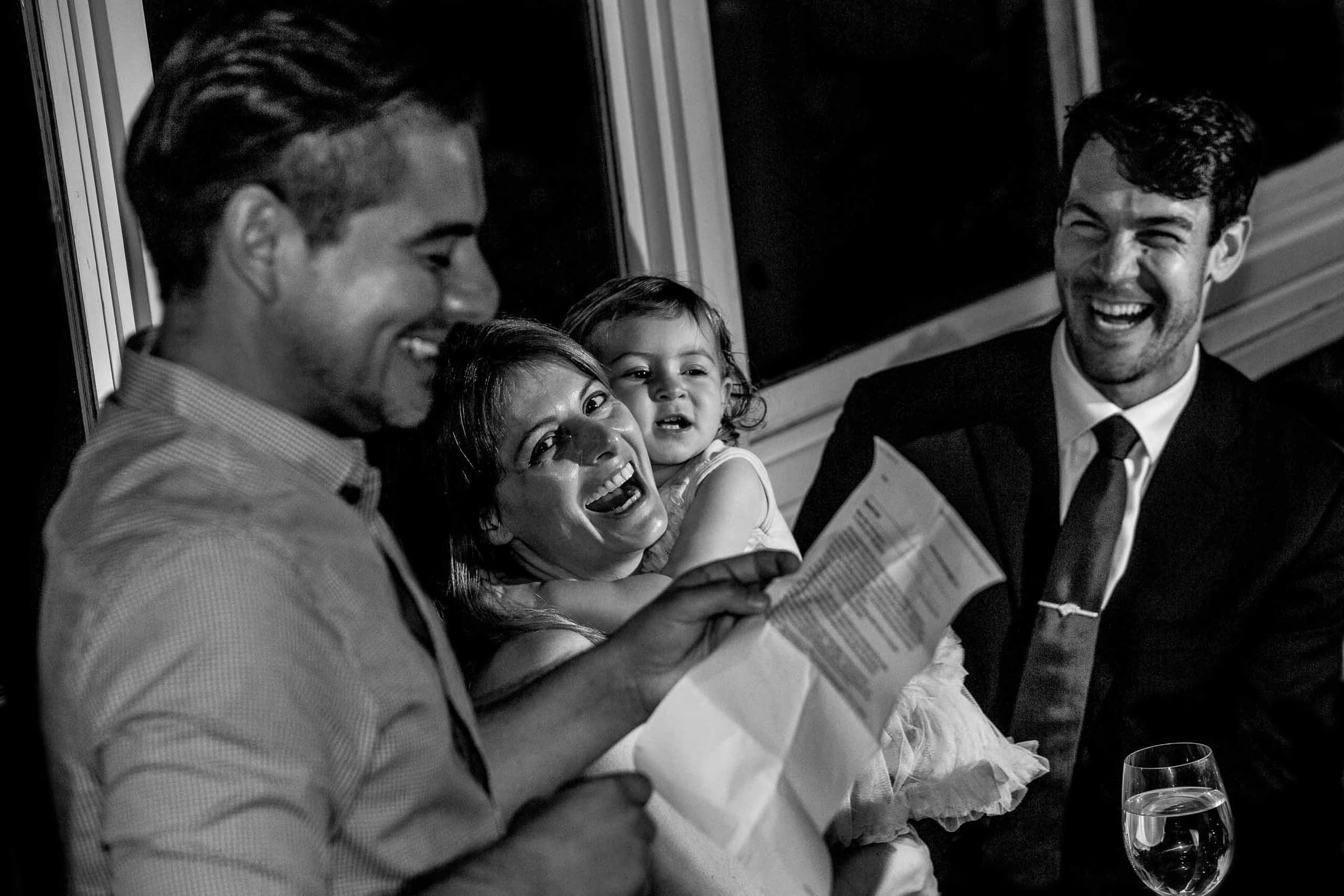 Bride and groom laughing during best man speech during their Lima Peru Wedding pre-party