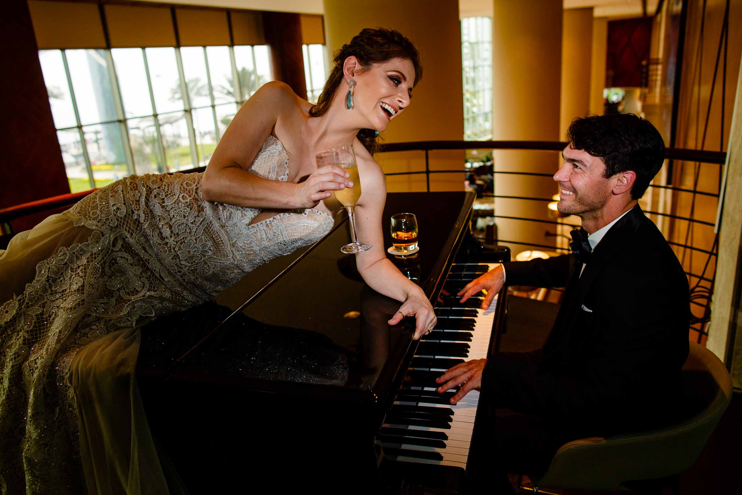 Bride and groom playing piano together for their Lima Peru Wedding.