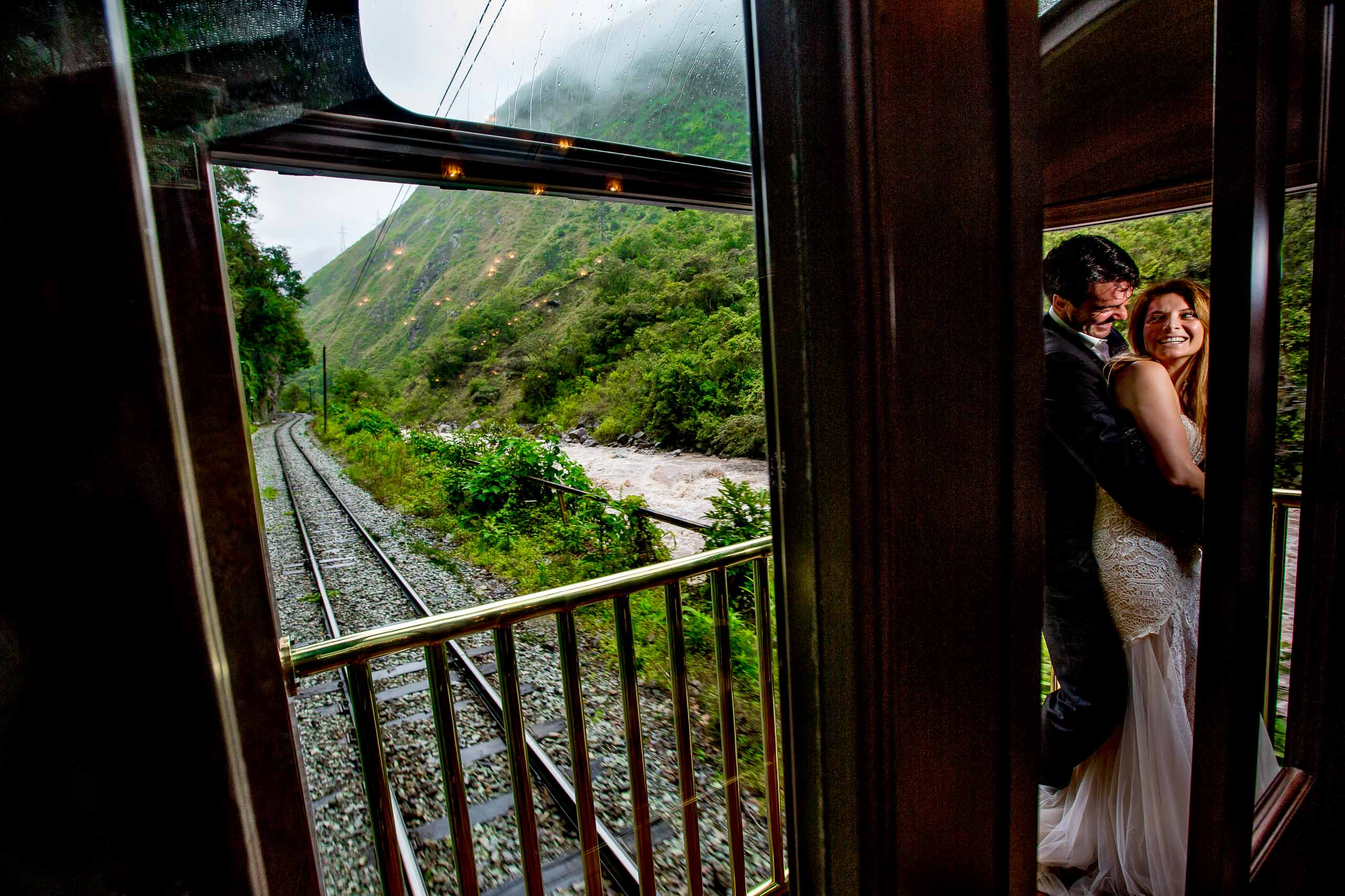 Bride and groom on a train headed to their Lima Peru Wedding