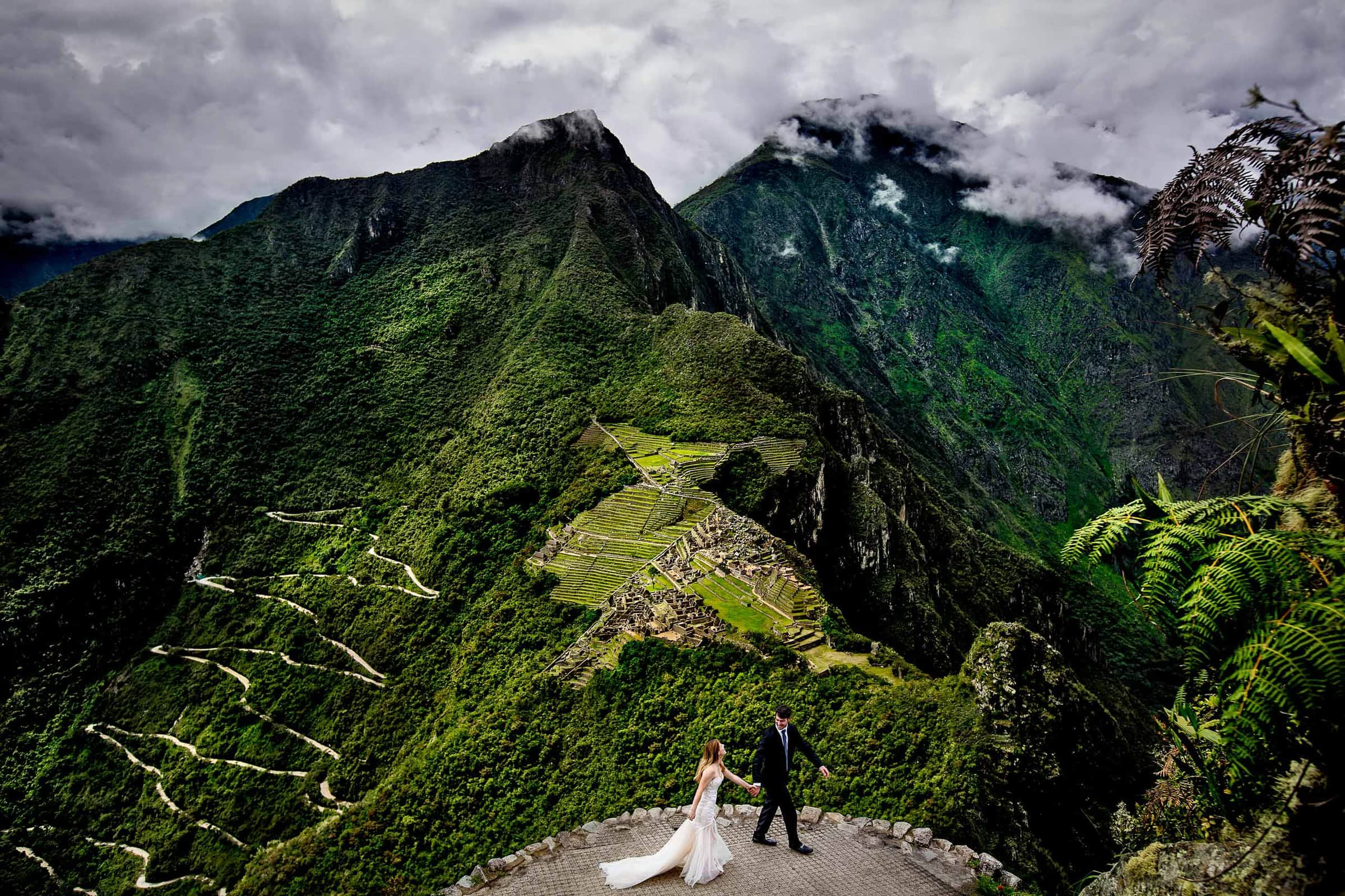 Bride and groom portrait on the top of Huayna Picchu above Machu Picchu during their Lima Peru Wedding