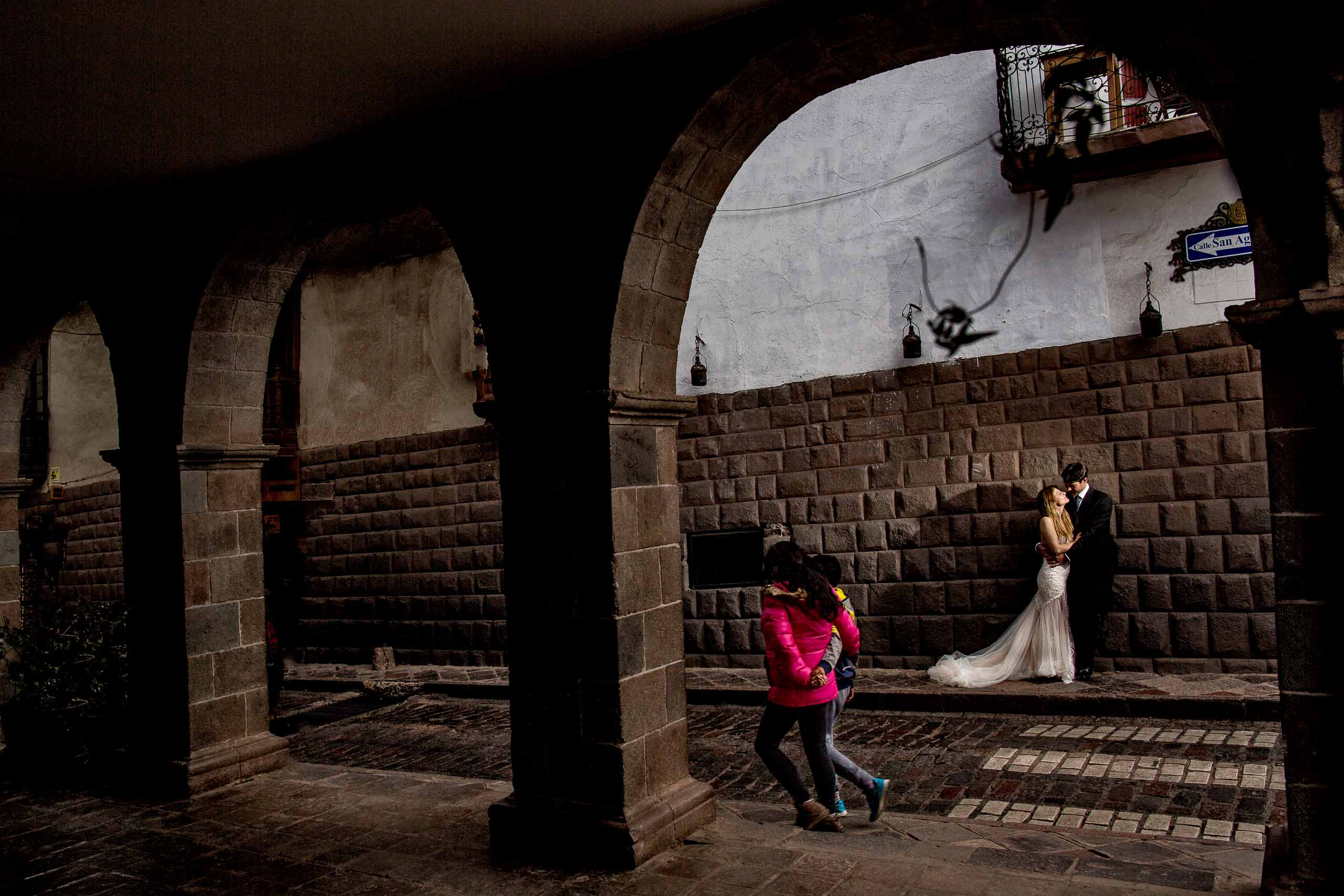 Bride and groom on the streets of Cusco