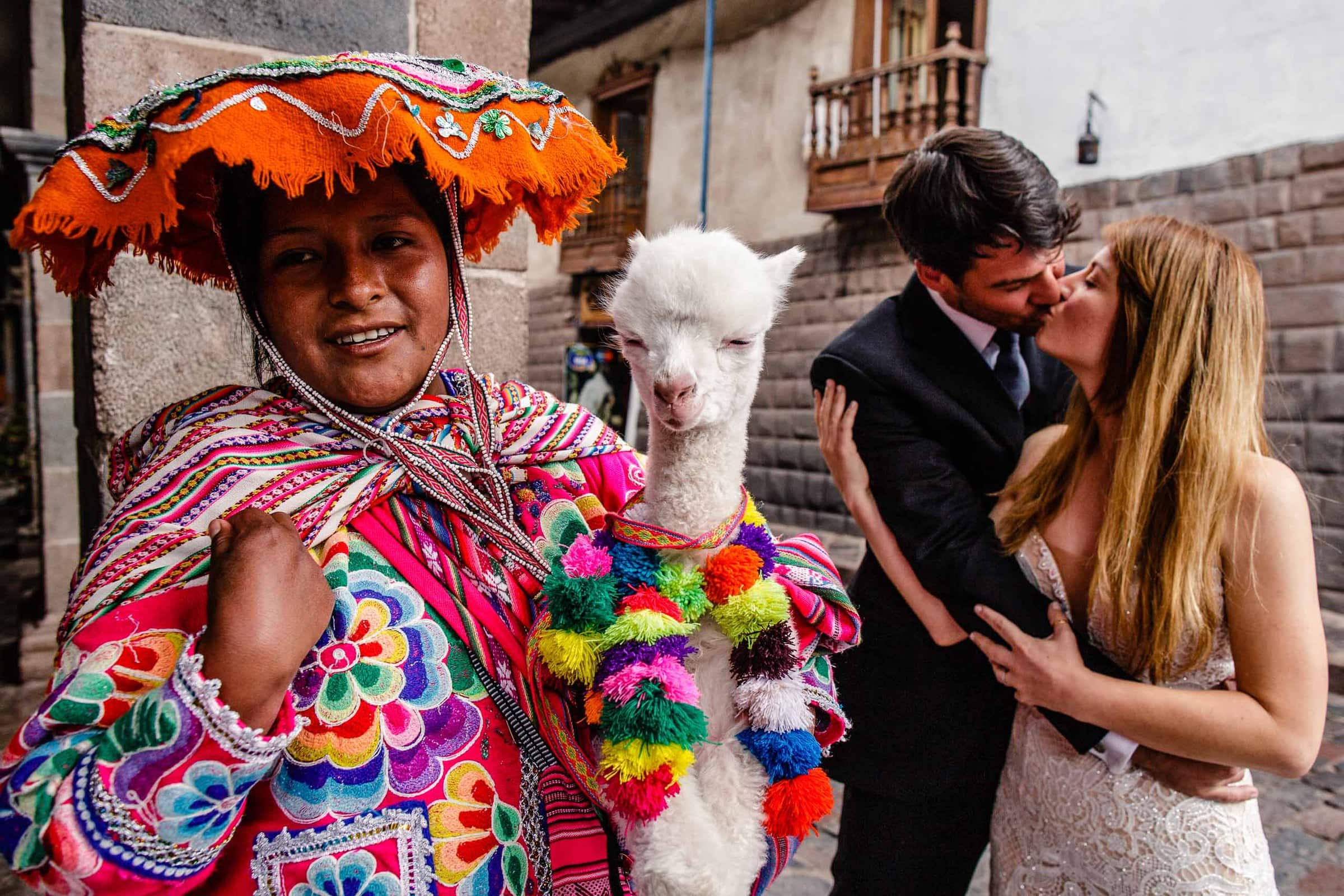 Bride and groom with a baby alpaca during their Lima Peru Wedding