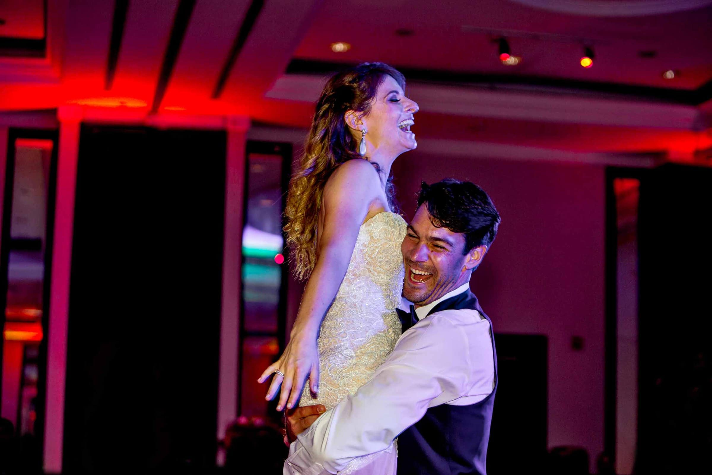 Bride and groom having the time of their life on the dance floor during their Lima Peru wedding