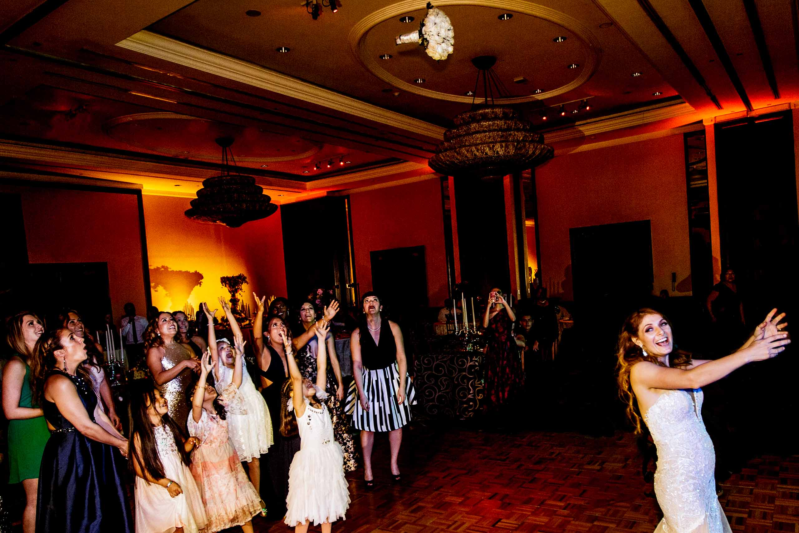 Bride throwing flowers on the dance floor during their Lima Peru wedding