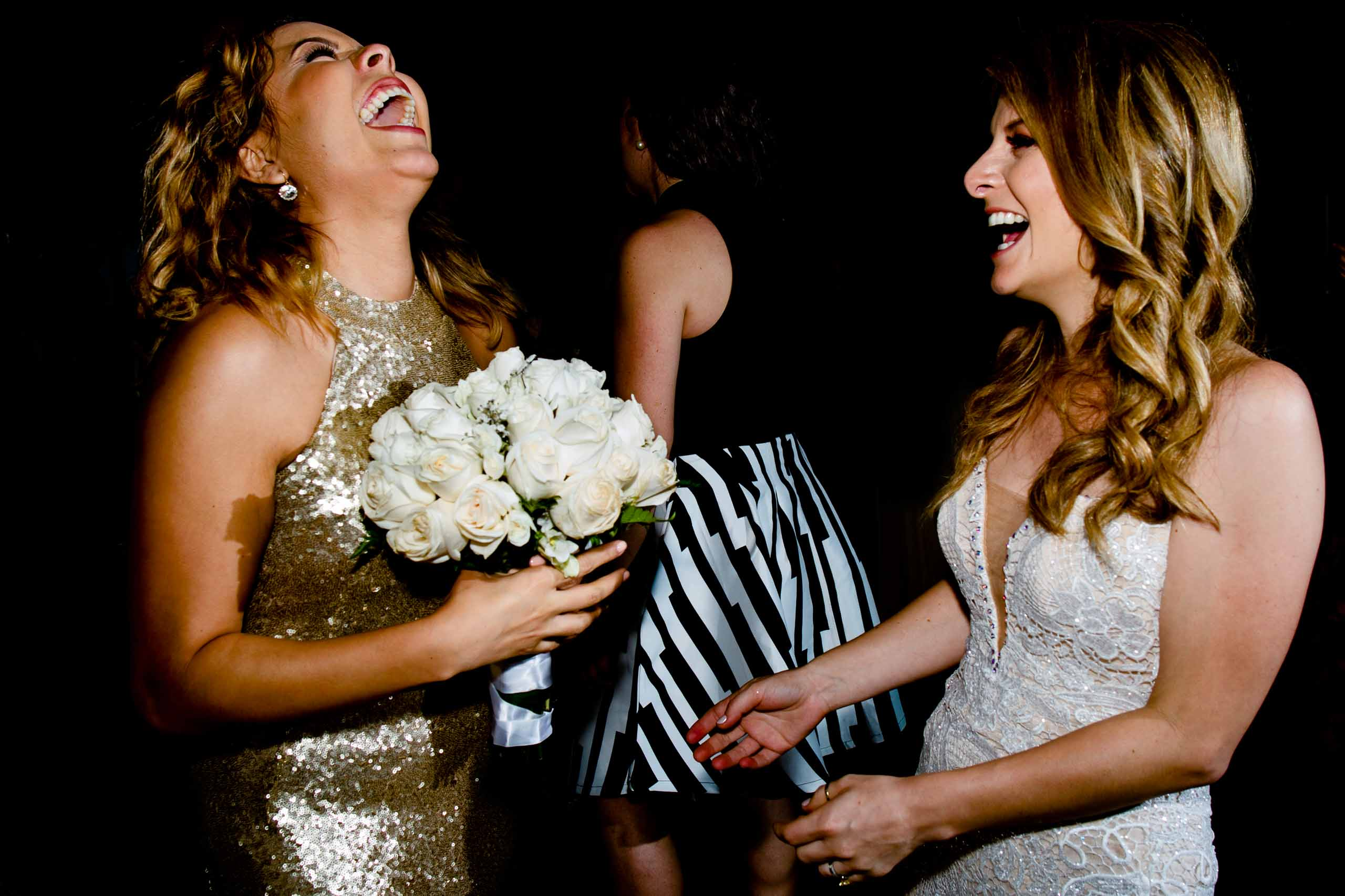 Bride having the time of her life with best friends on the dance floor during their Lima Peru wedding