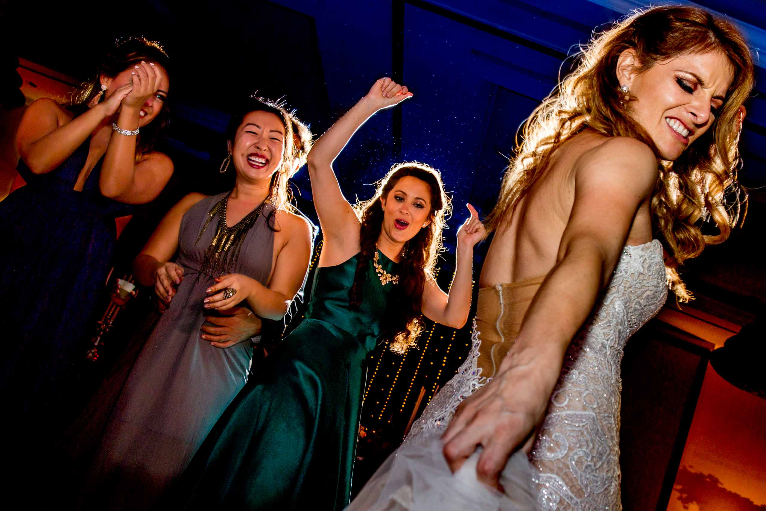Bride having the time of her life on the dance floor during their Lima Peru wedding