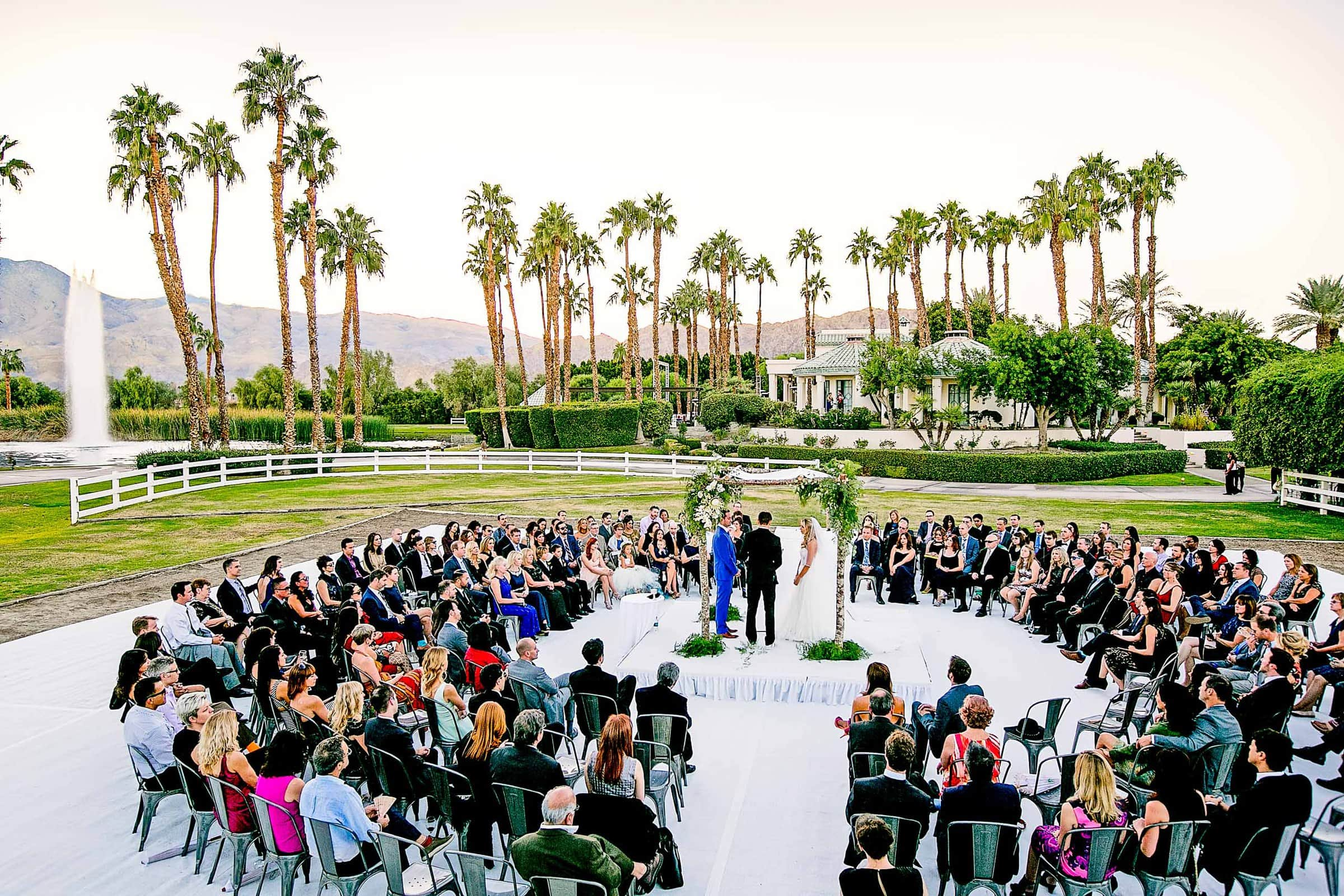 Gorgeous wide angle view of a Merv Griffin Estate Wedding ceremony in Palm Springs