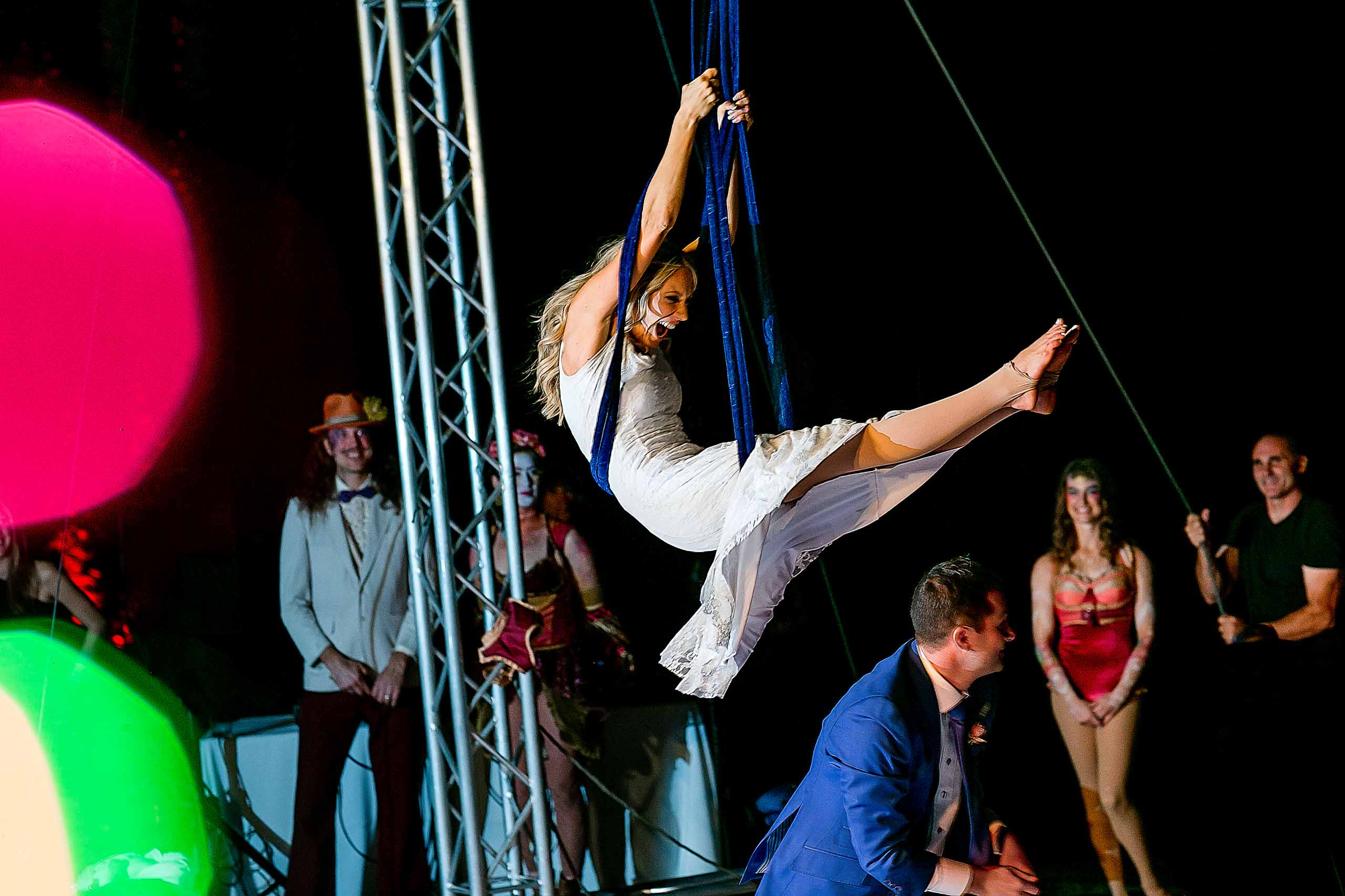 Bride flying in on silks swinging with her groom at a Merv Griffin Estate wedding in Palm Springs