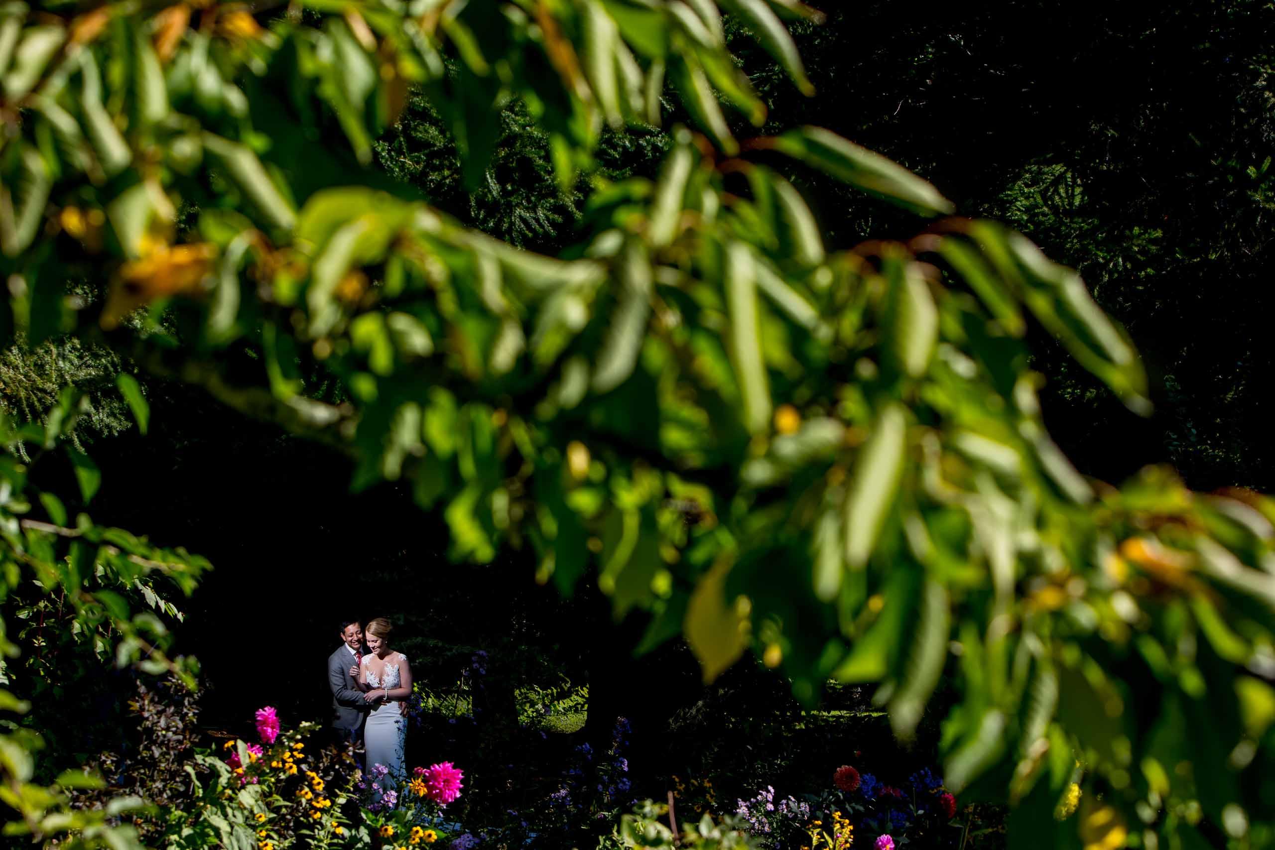 Creative photo of a bride and groom before their Mt Hood Organic Farms wedding near Hood River Oregon