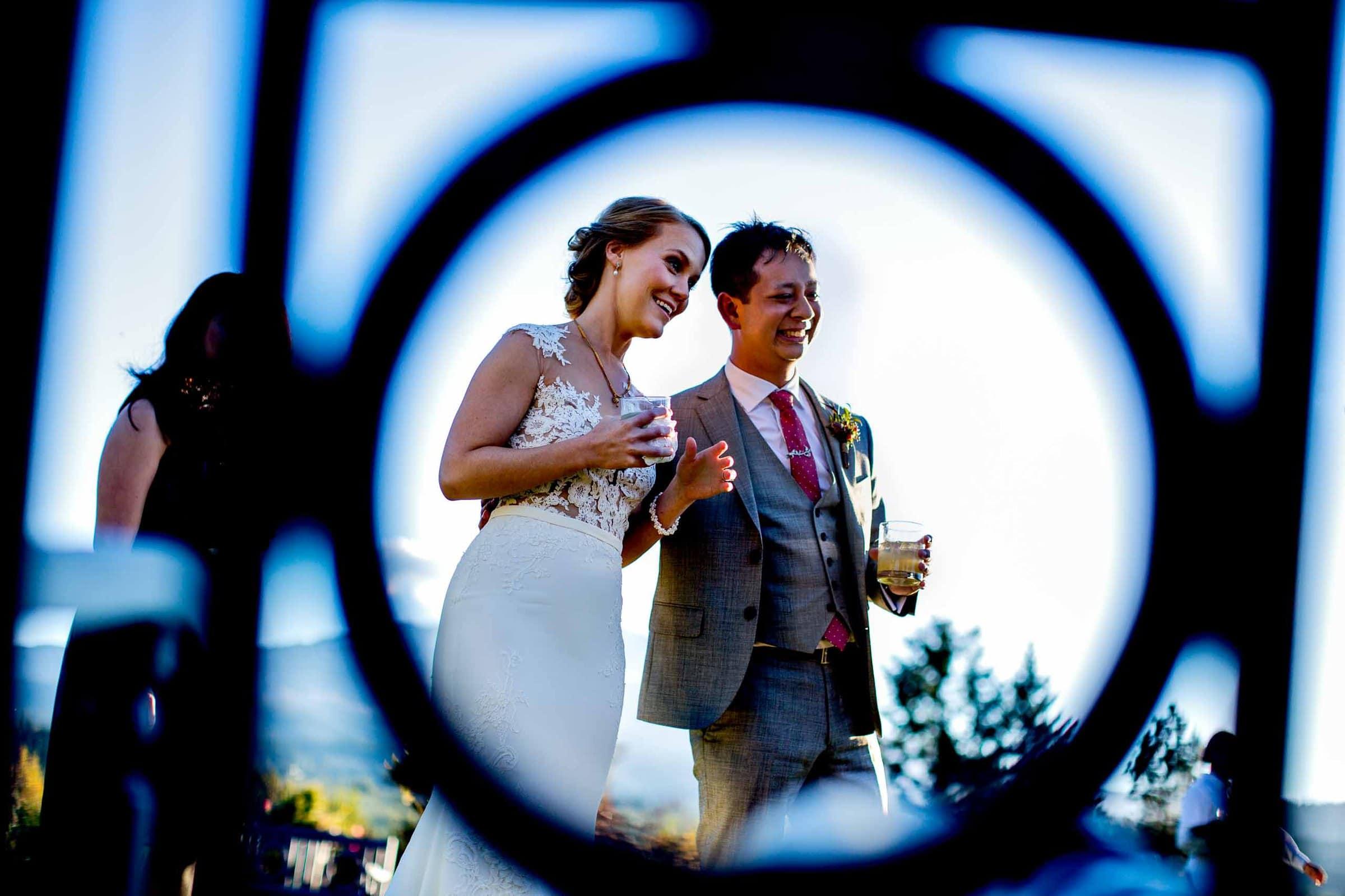 Bride and groom portrait through a design during a Mt Hood Organic Farms wedding reception near Hood River Oregon
