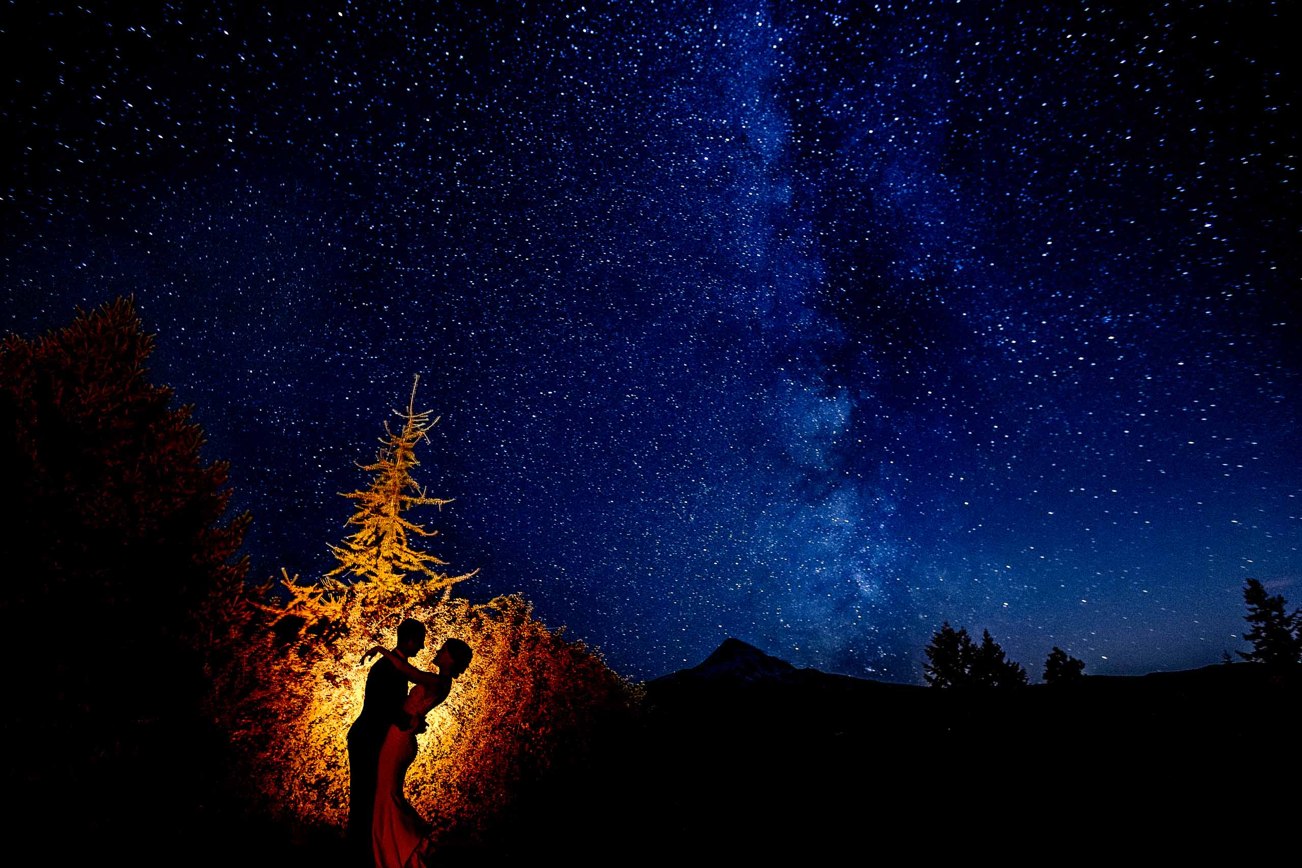Award winning astro photo of a bride and groom during their Mt Hood Organic Farms Wedding near Hood River Oregon. Creative photo by Jos and Tree.