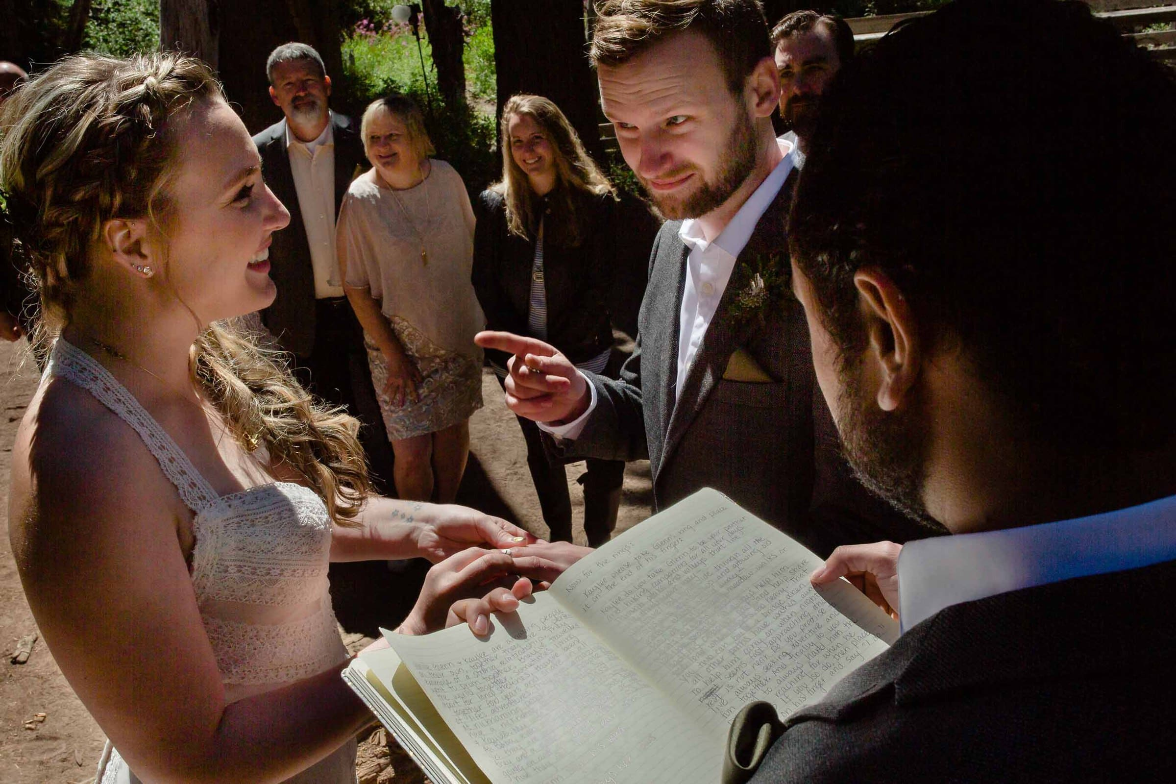 Comical photo of a groom questioning his brides vows during their Bride and groom exchanging vows during their Mt Hood Meadows wedding at Umbrella Falls