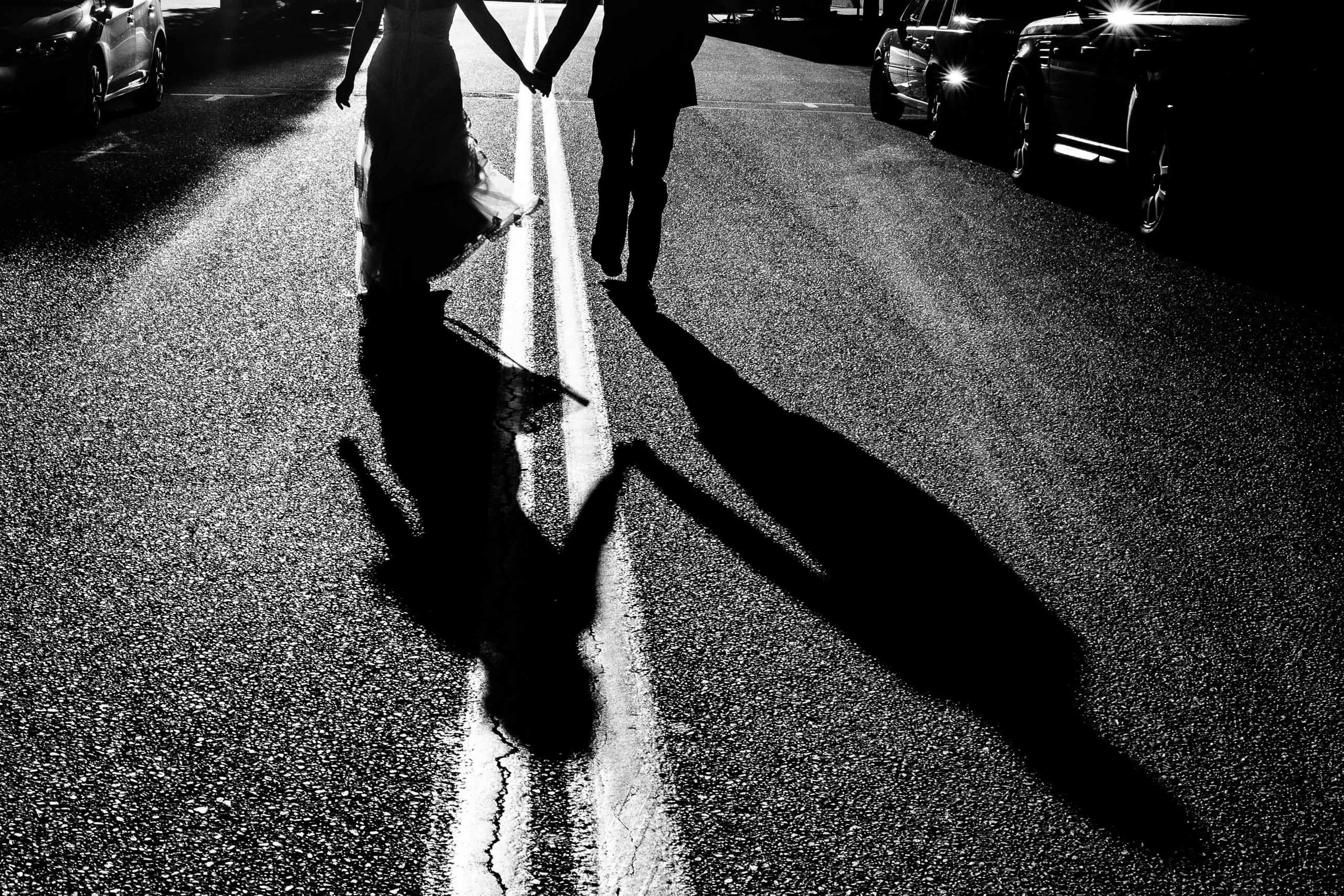 Bride and groom playing in urban Portland streets following their Mt Hood Meadows wedding at Umbrella Falls