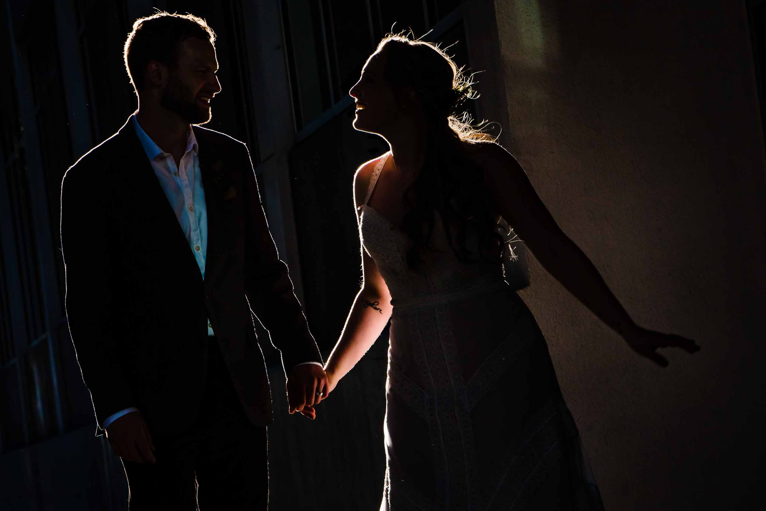 Fun silhouette photos of bride and groom walking through Portland streets following their Mt Hood Meadows wedding at Umbrella Falls