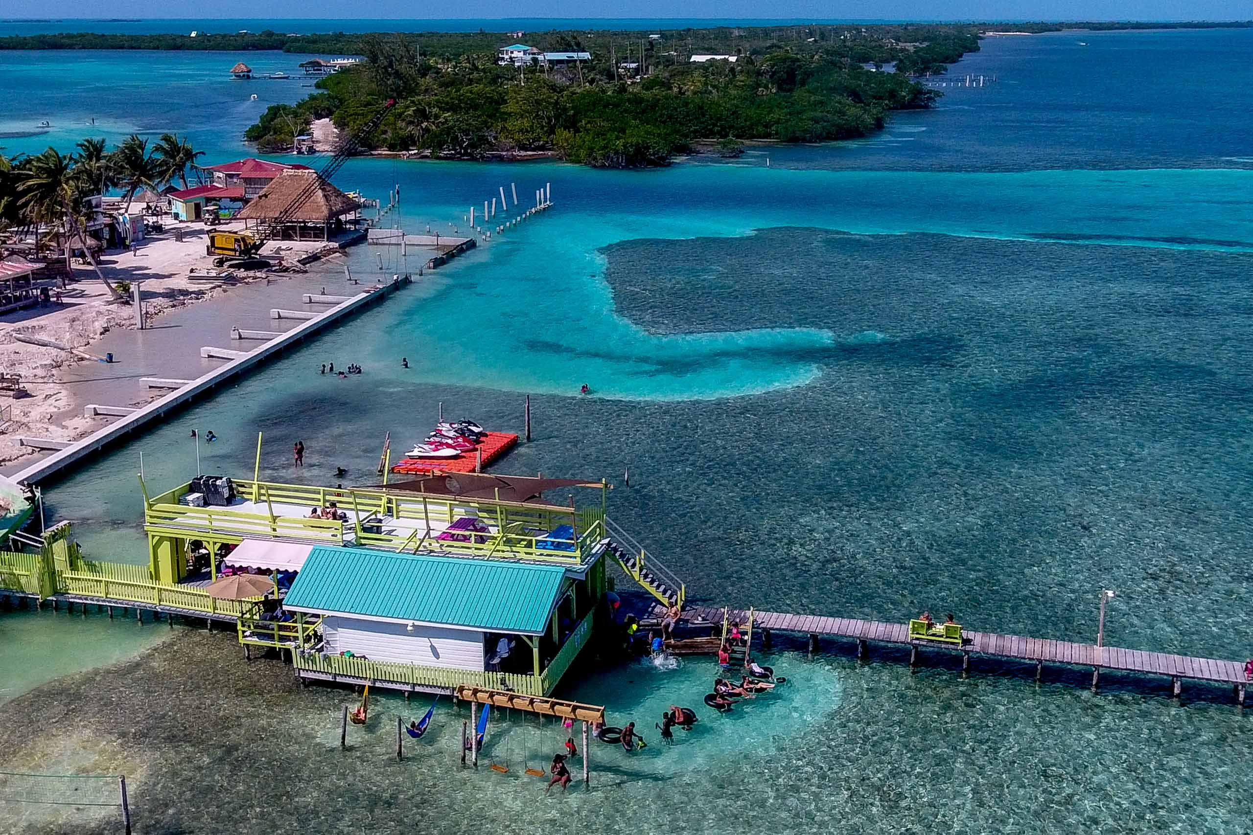 Wide angle drone photo of beach front for a Portofino Beach Resort wedding in Belize