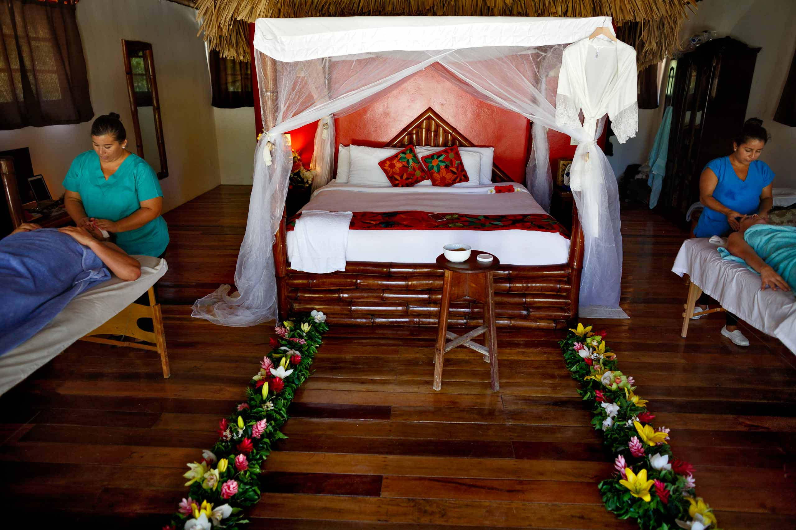 Bride and groom enjoying a massage the day before their Portofino Beach Resort wedding in Belize.