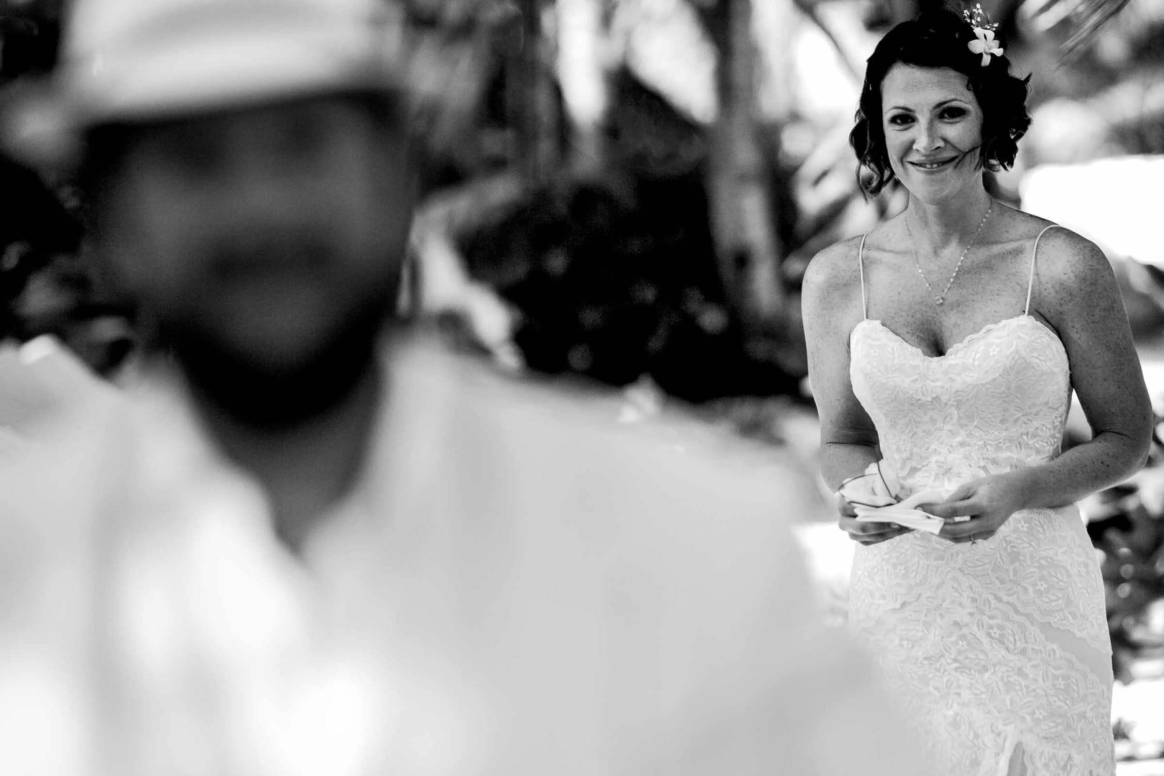 Bride approaching her groom for their first look during their Portofino Beach Resort wedding in Belize