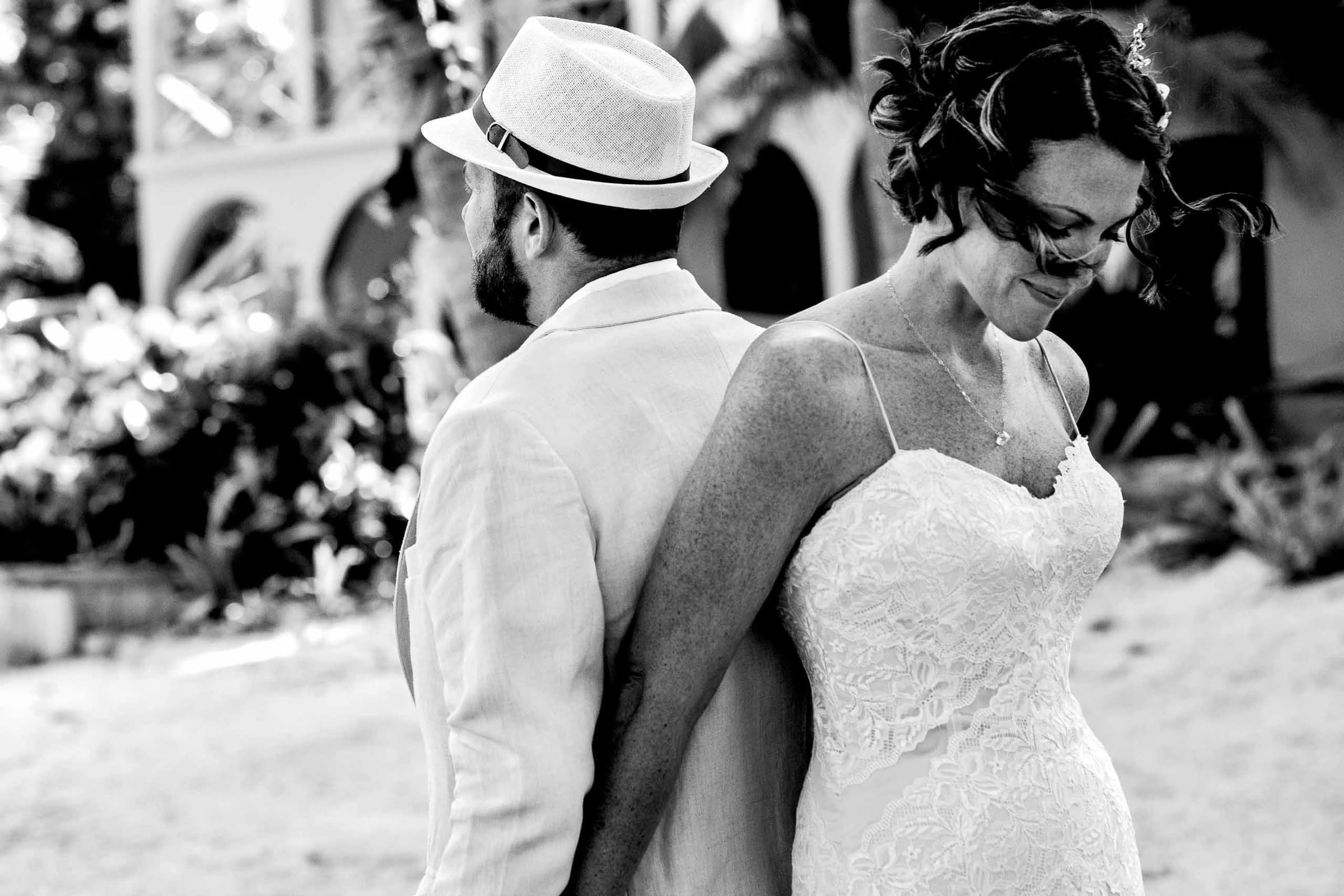 Bride and groom first touch during the morning of their Portofino Beach Resort Wedding in Belize