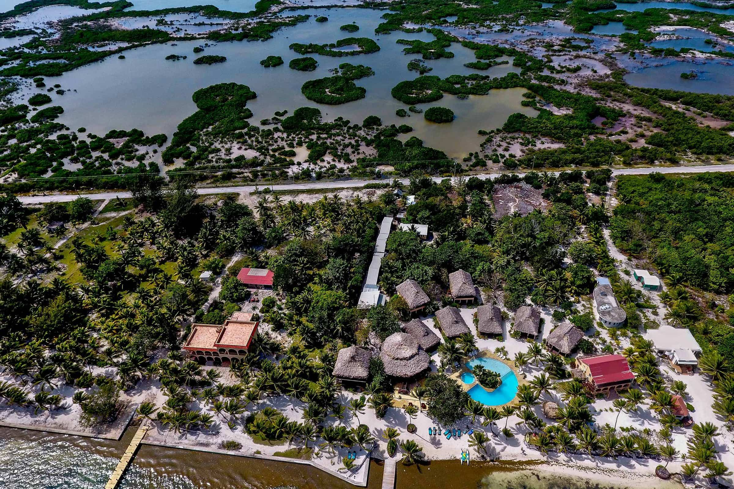 Wide angle view drone photo of Nikki and Paul's Portofino Beach Resort wedding property in Belize