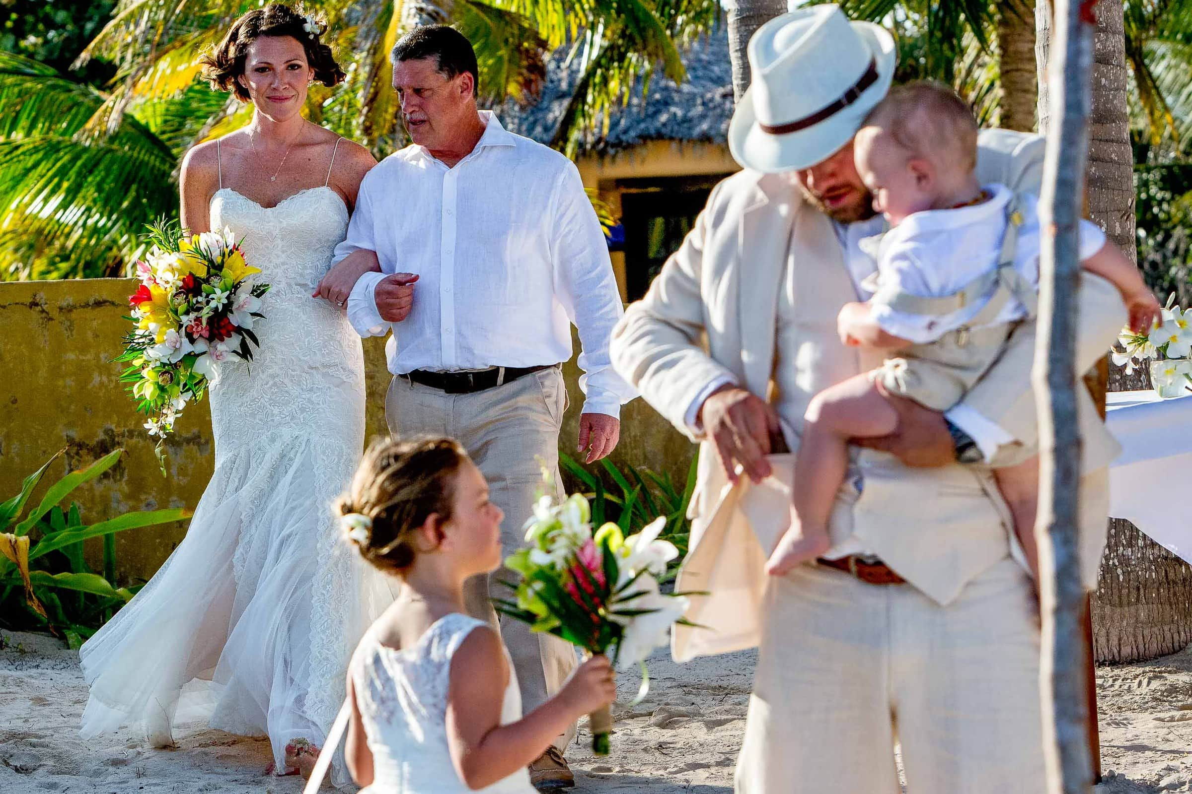 Bride walking into her Portofino Beach Resort wedding in Belize