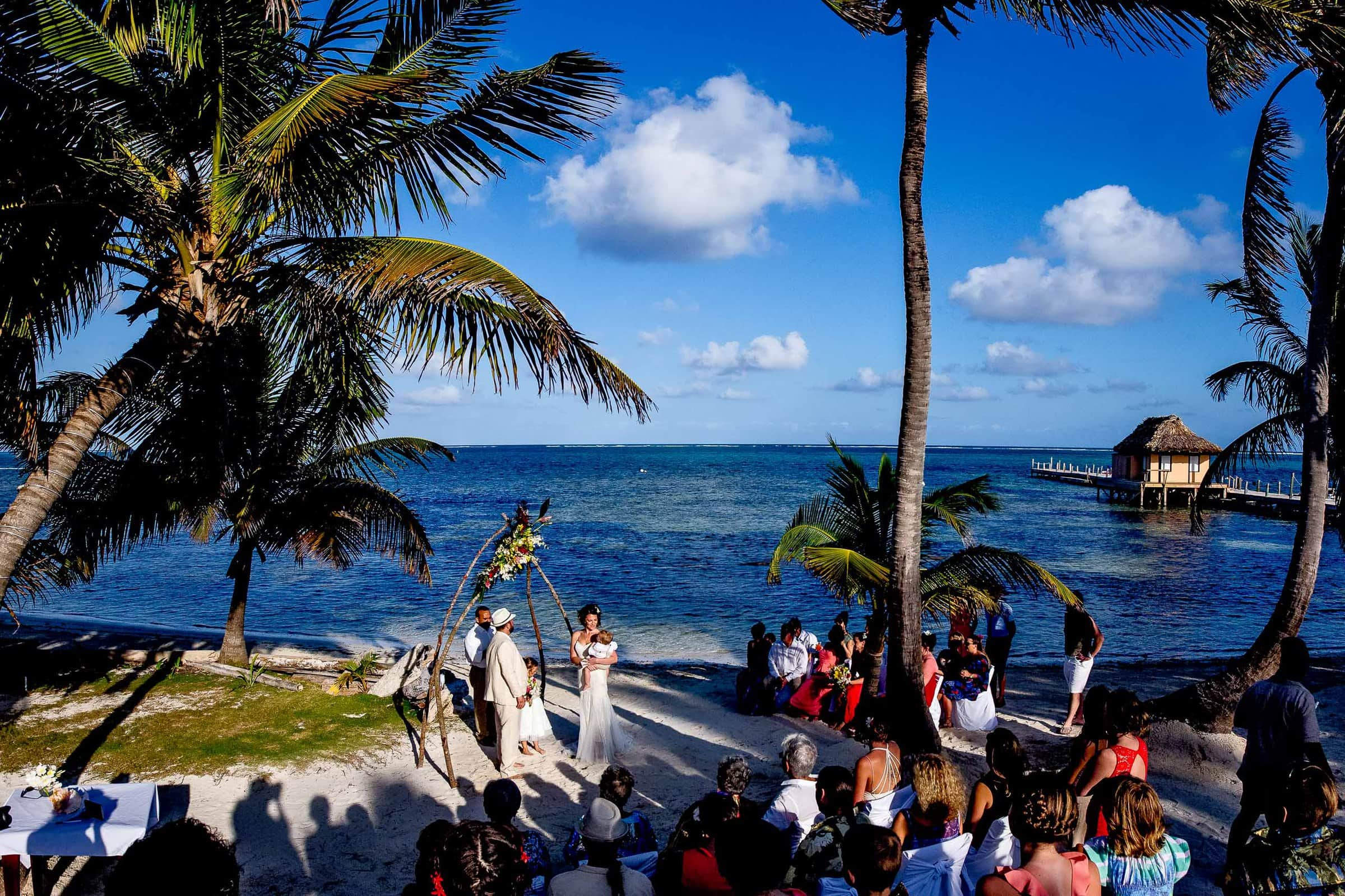 Nikki and Paul's Portofino Beach Resort wedding ceremony with family and friends in Belize