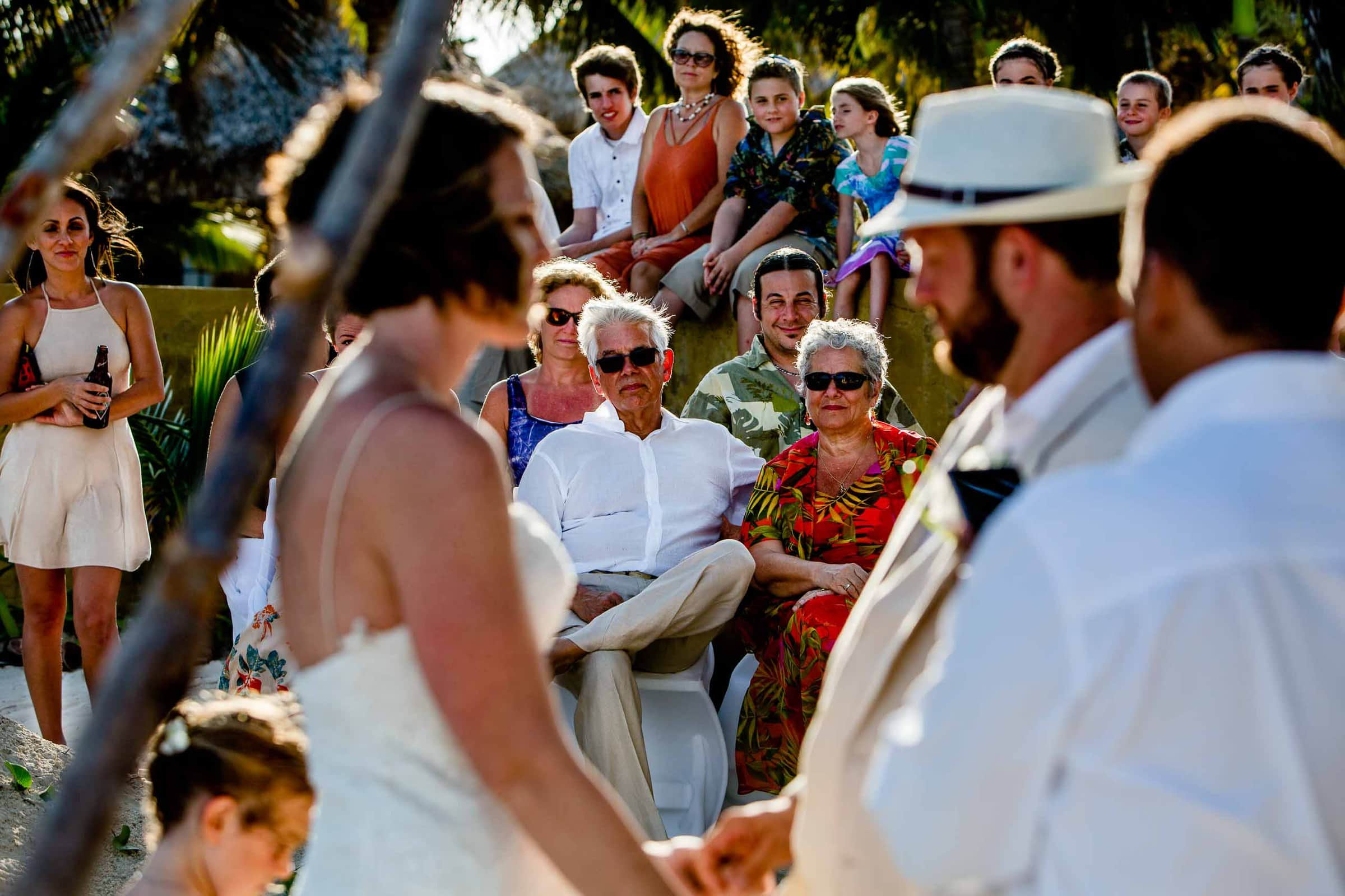 Photo of parents during Nikki and Paul's Portofino Beach Resort Wedding ceremony in Belize