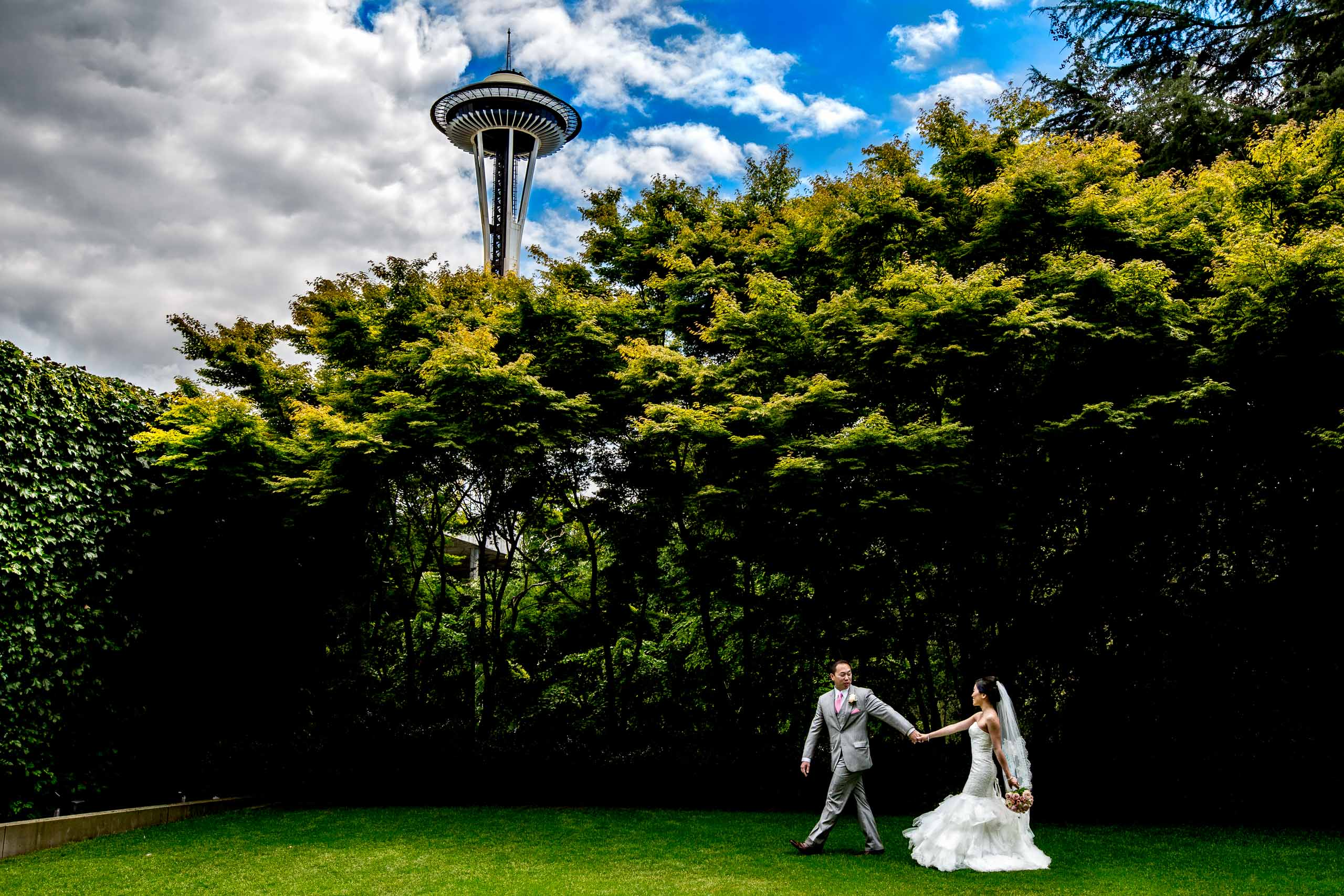 Portrait of a bride and groom with the Space Needle in the background before their Saltys wedding in Seattle, Washington.