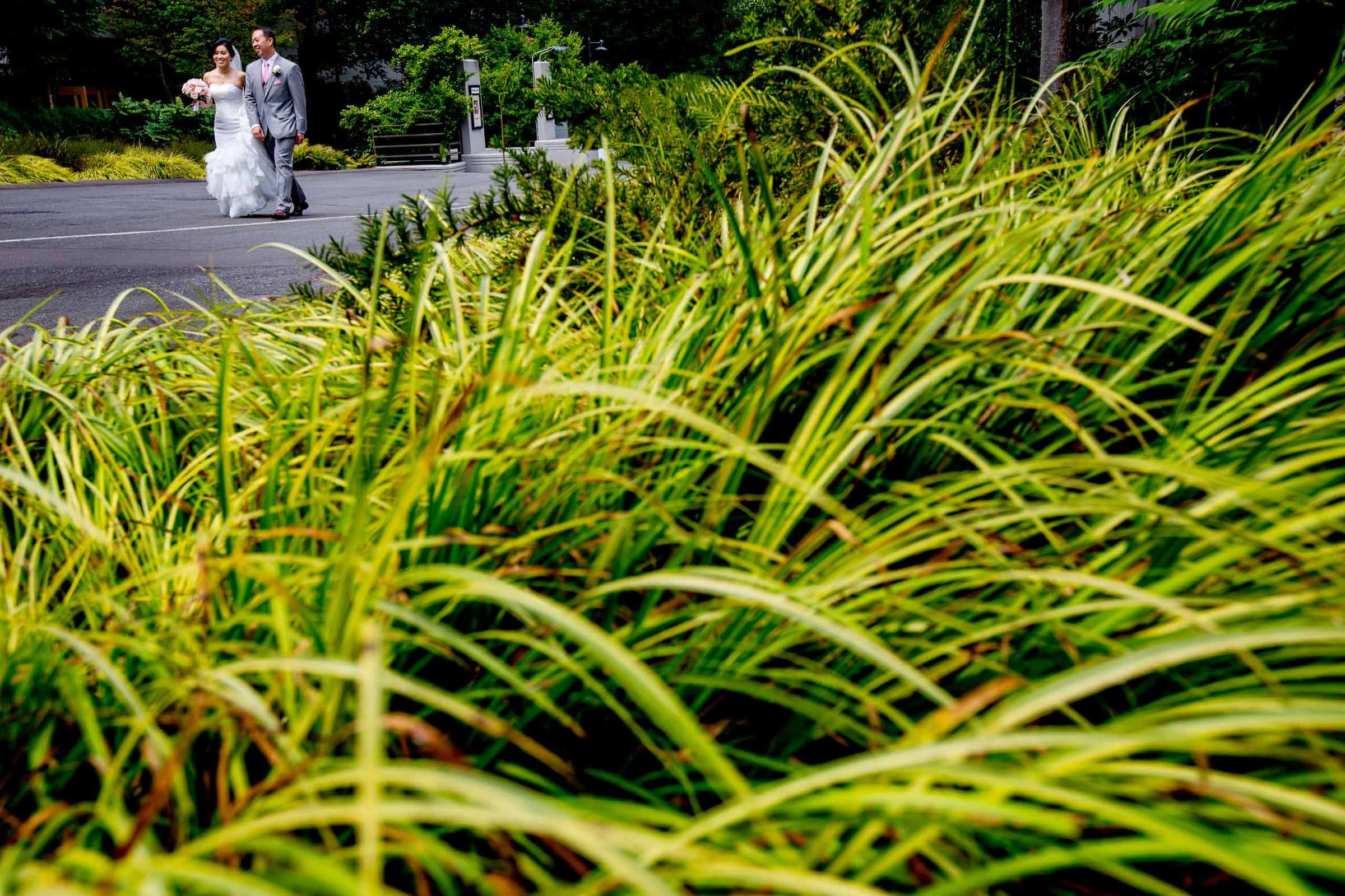 Action photo of a bride and groom walking toward their Saltys wedding in Seattle, Washington.