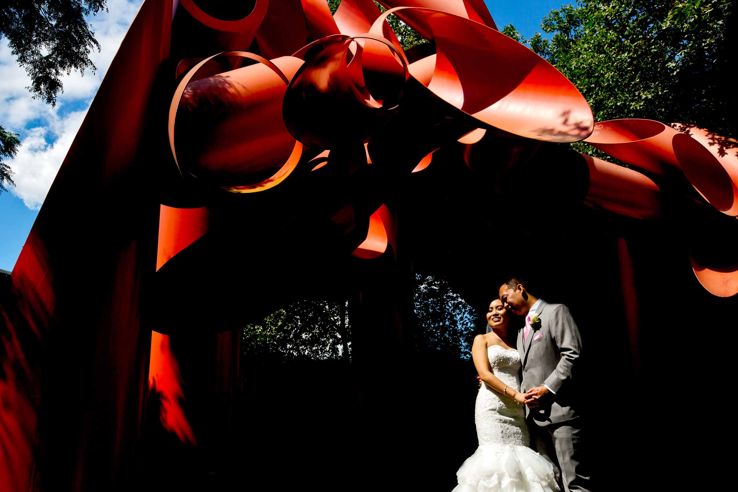 Creative photo of a bride and groom near the Museum of Pop Culture before their Saltys wedding in Seattle, Washington.
