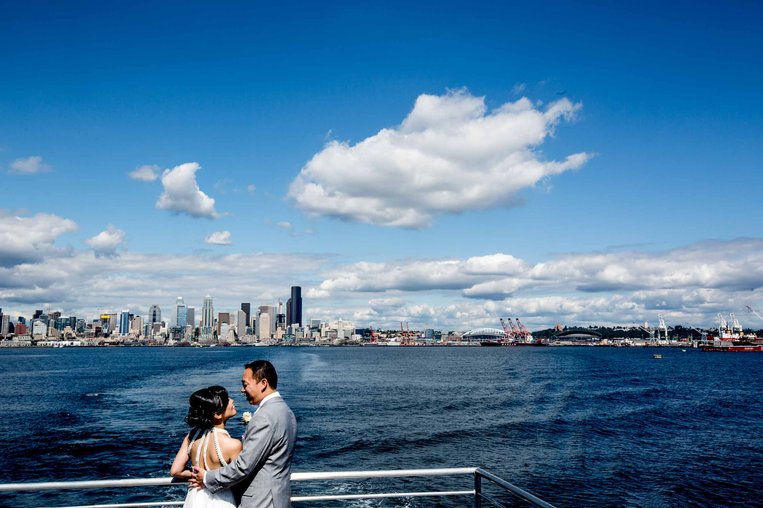 Creative photo of a bride and groom along the waterfront park before their Saltys wedding in Seattle, Washington.