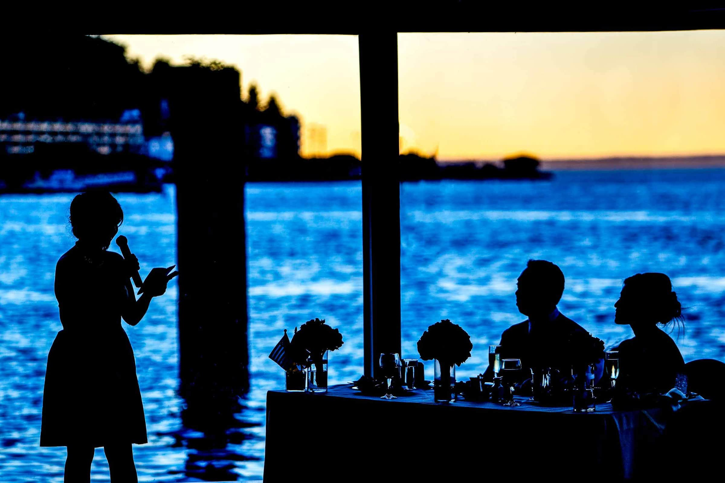 Creative silhouette photo of a Saltys wedding reception with the sunset
