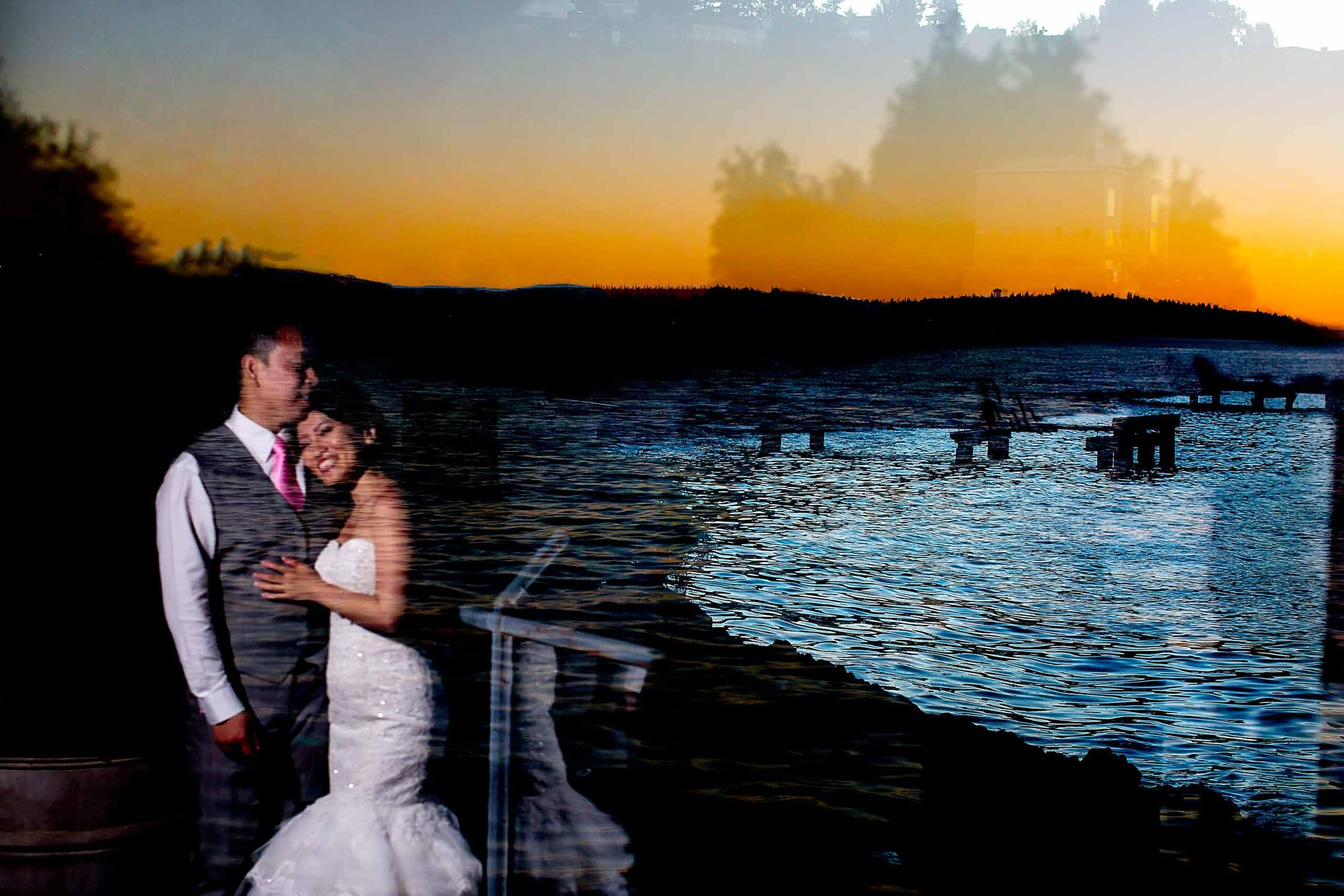 Creative portrait of a bride and groom during their Saltys wedding ceremony with Seattle's city scape in the background.