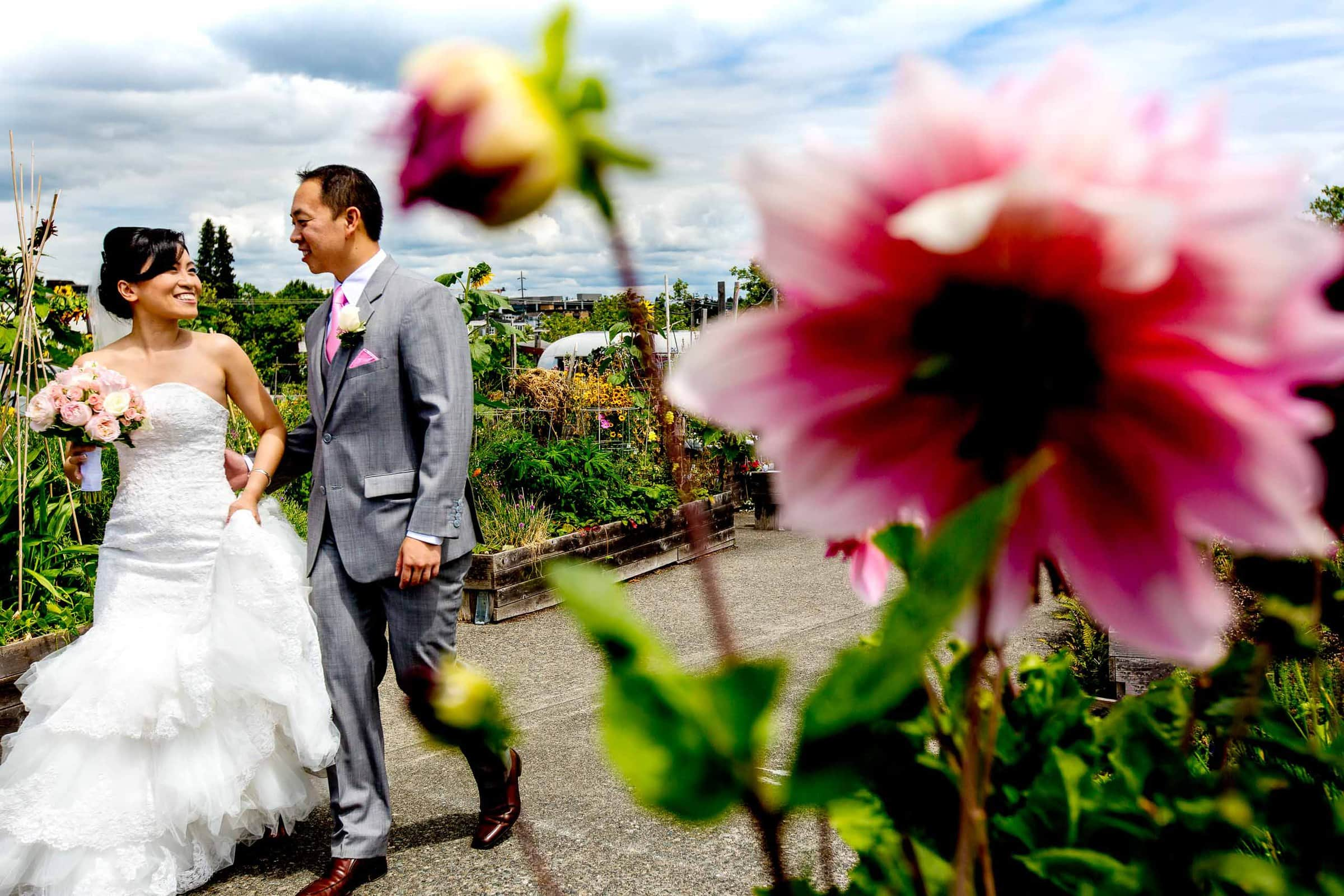 Bride and groom walking together before a Saltys wedding in Seattle, Washington. Award winning wedding photographers by Jos and Tree.