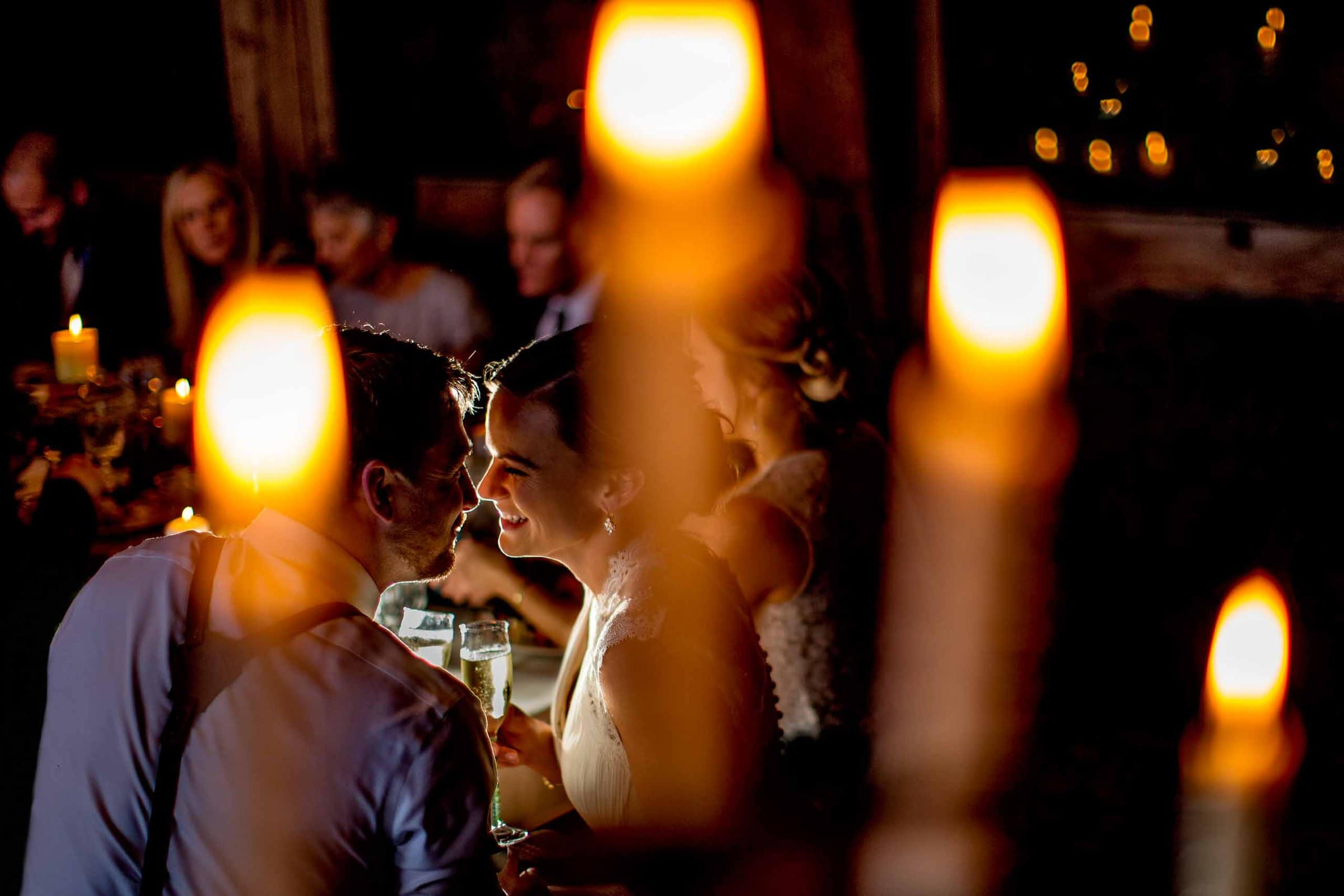 Gorgeous intimate wedding reception at Silcox Hut above Timberline Lodge. Bride and Groom enjoying reception dinner with candle light.