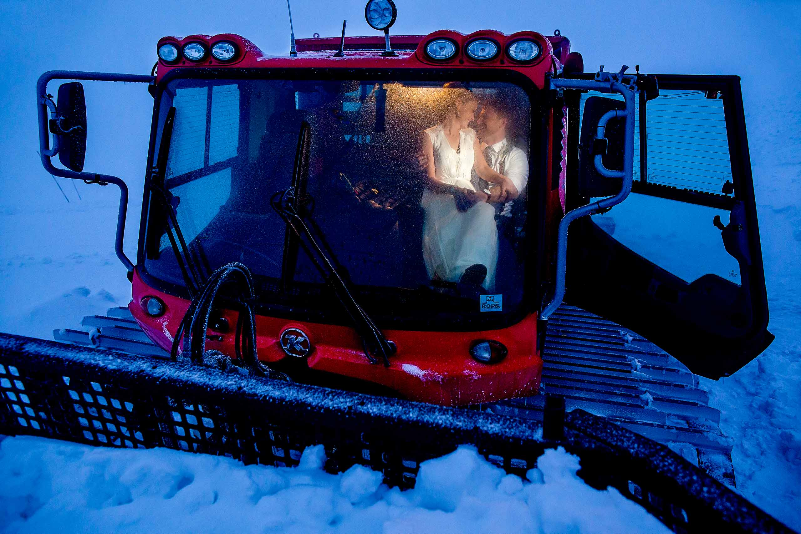 Bride and Groom inside snow cat outside Silcox Hut above Timberline Lodge