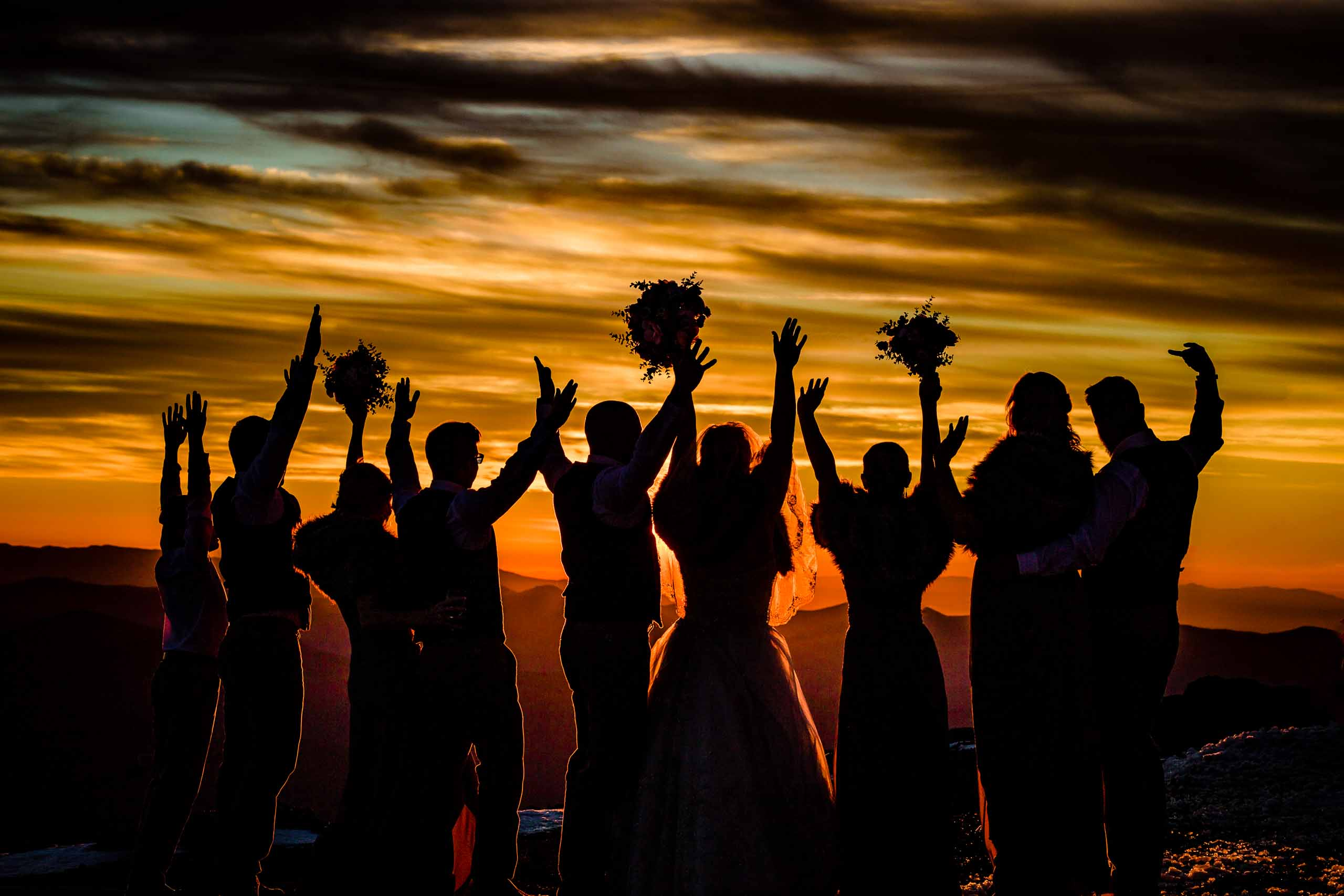 Beautiful sunset photo of bridal party for a Silcox Hut Wedding at Timberline Lodge on Mt Hood.