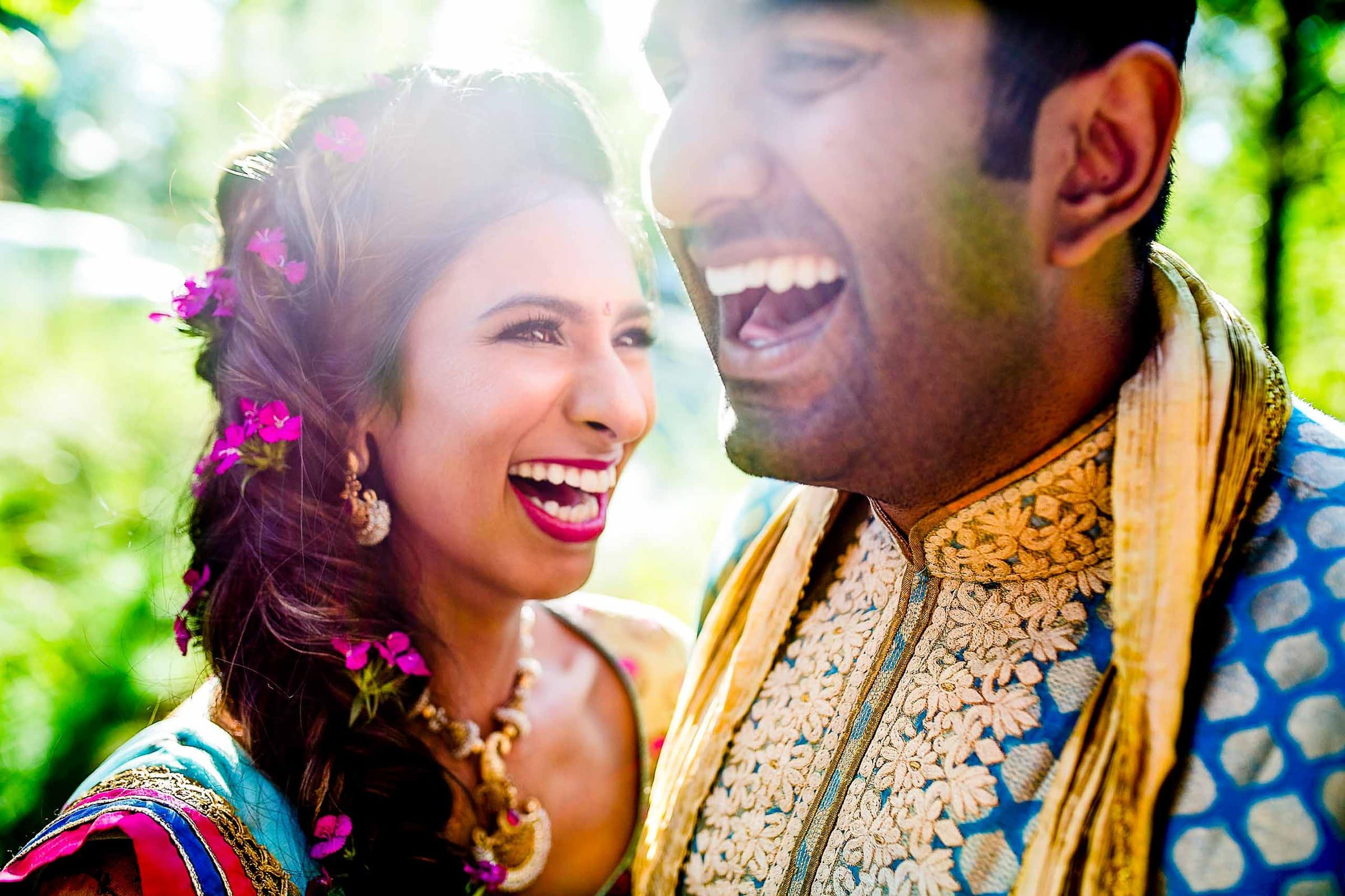 Indian couple laughing in beautiful sunlight at Sunriver Resort in Bend, Oregon