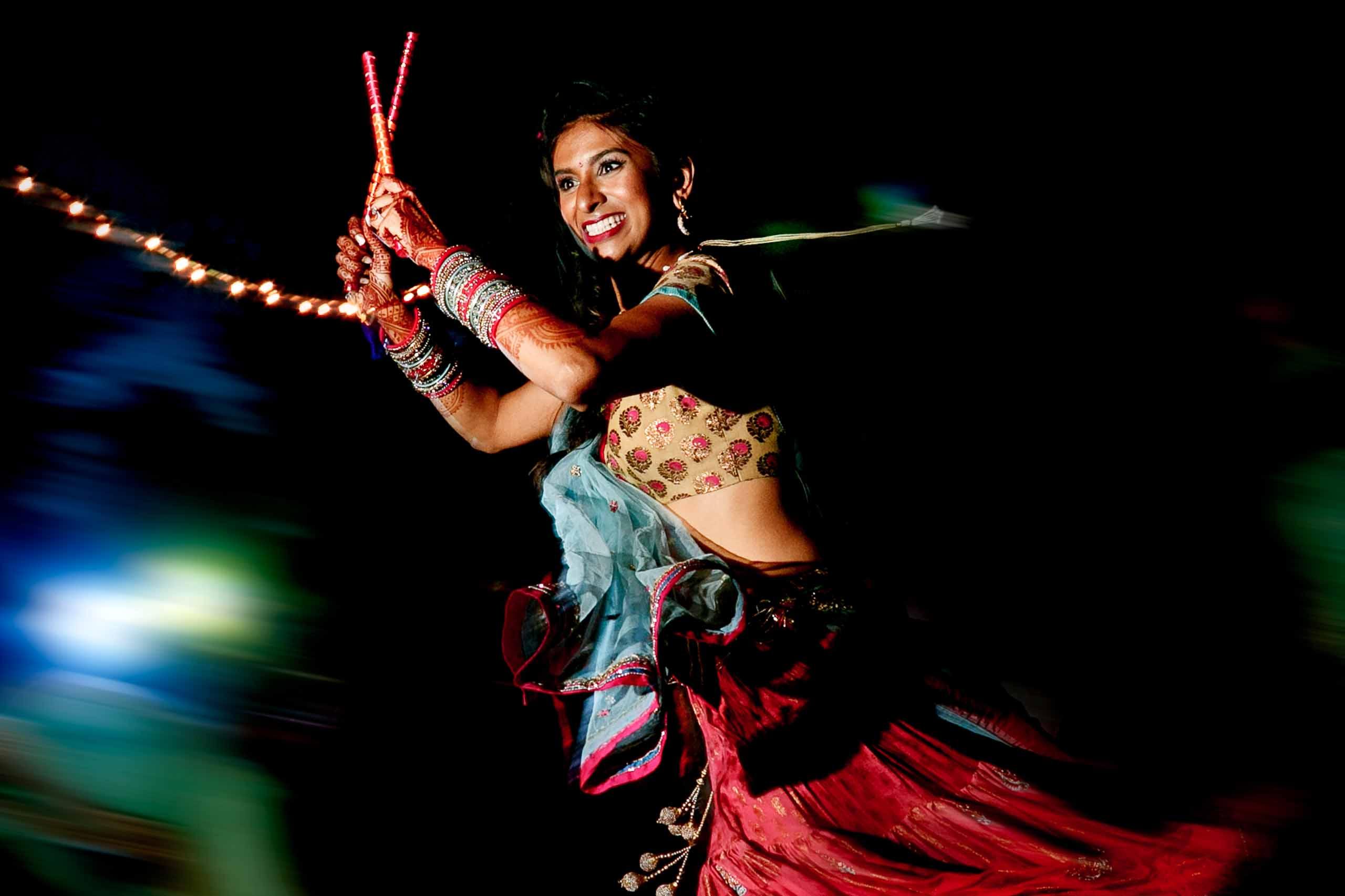 Indian bride dancing the night before her Sunriver Resort wedding in Bend Oregon in Central Oregon.