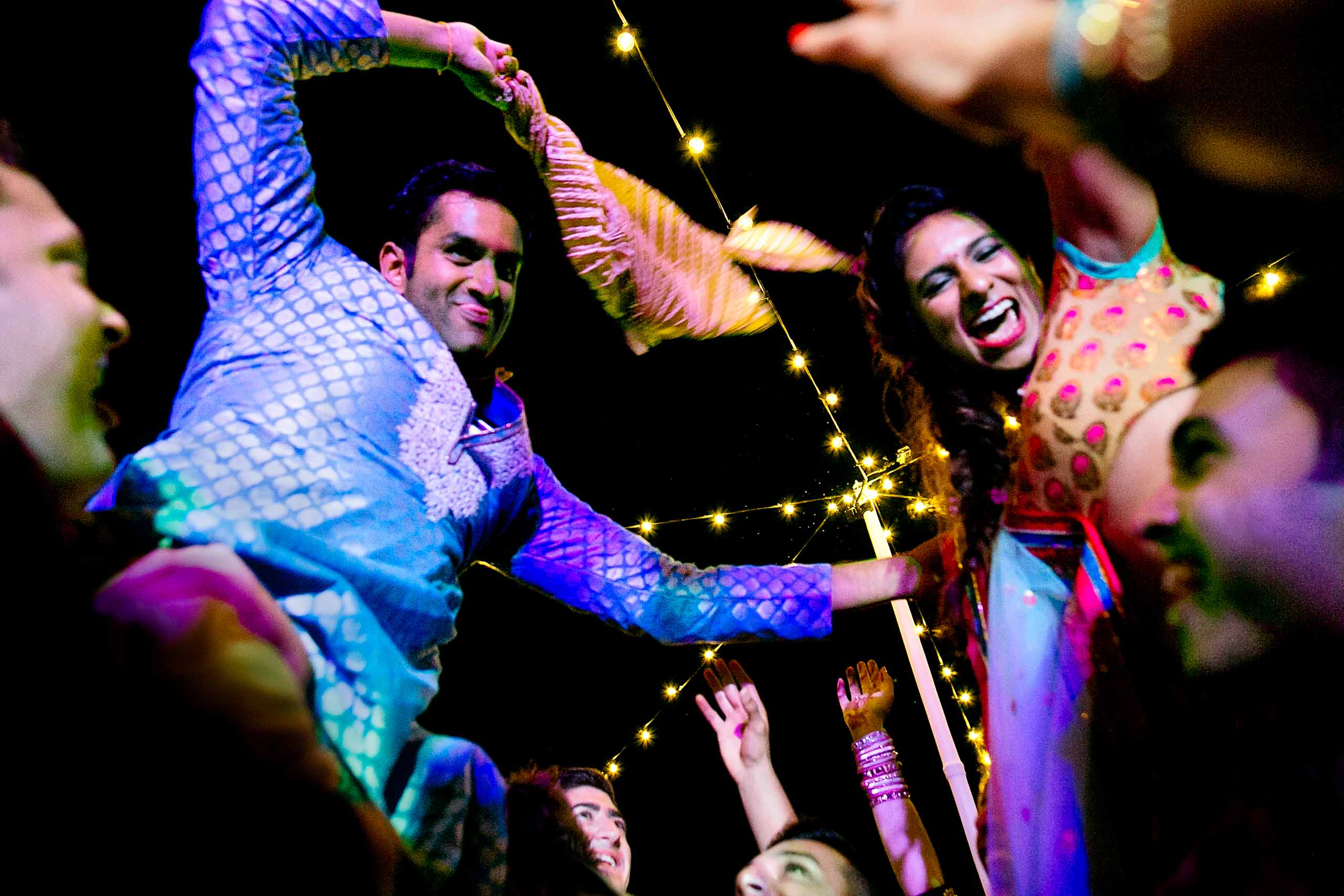 Indian bride and groom dancing wild the night before their Sunriver Resort wedding in Bend Oregon in Central Oregon.