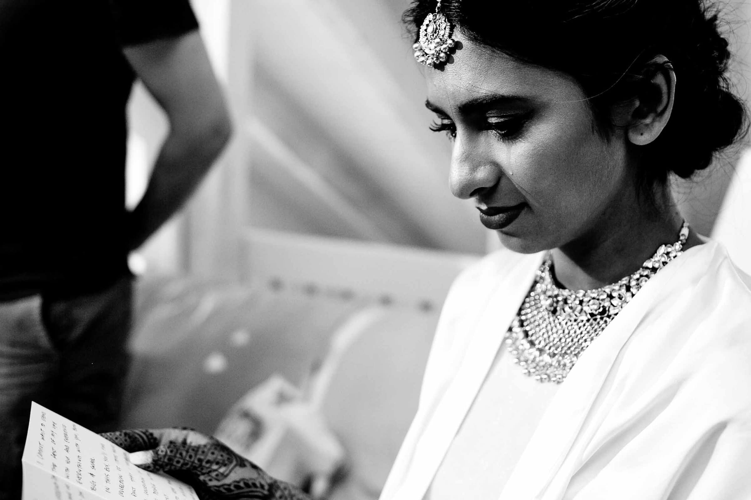 Emotional Indian bride getting ready and reading love letter from her groom during her Sunriver Resort wedding in Bend Oregon in Central Oregon.