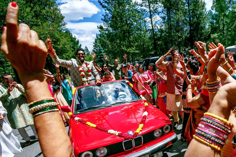Emotional Indian groom riding into his Sunriver Resort wedding in Bend Oregon in Central Oregon.