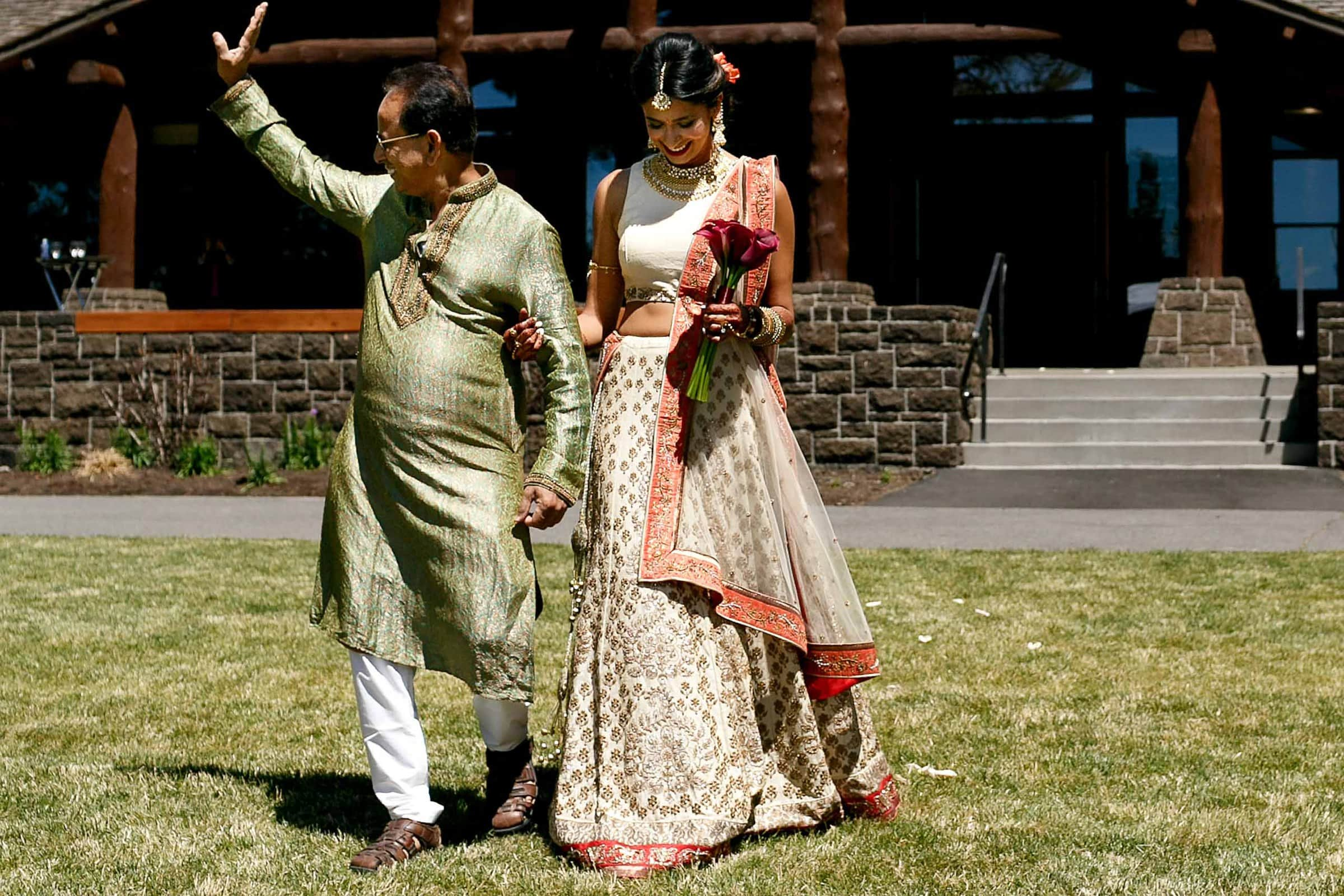 Indian bride walking with her father into her Sunriver Resort wedding in Bend Oregon in Central Oregon.