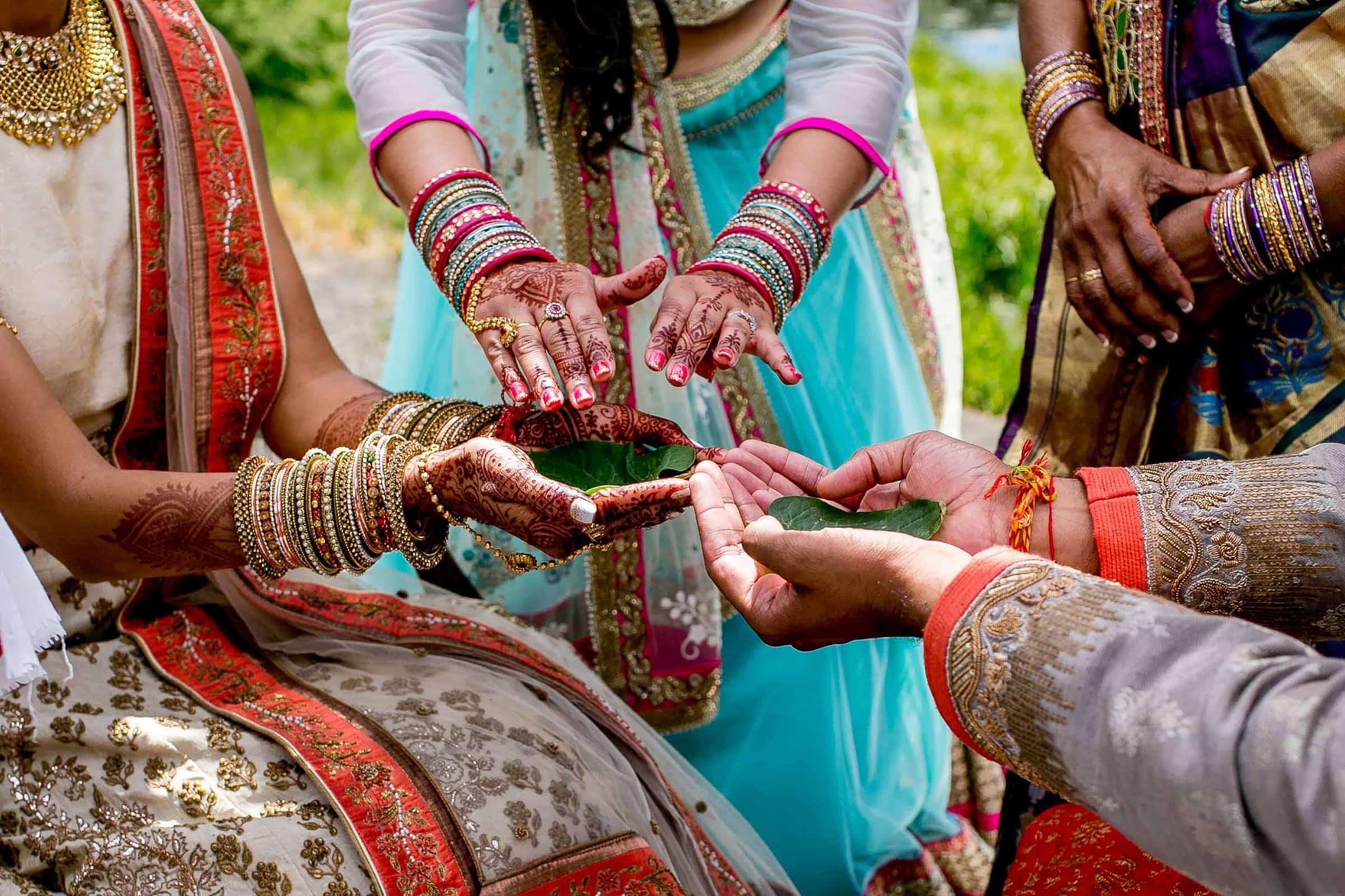 Colorful hands during an Indian Sunriver Resort wedding in Bend Oregon in Central Oregon.