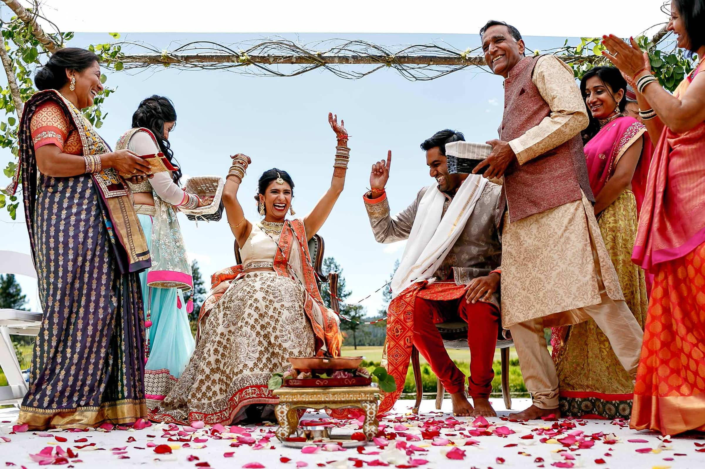 Happy photo of bride and groom and family during an Indian Sunriver Resort wedding in Bend Oregon in Central Oregon.